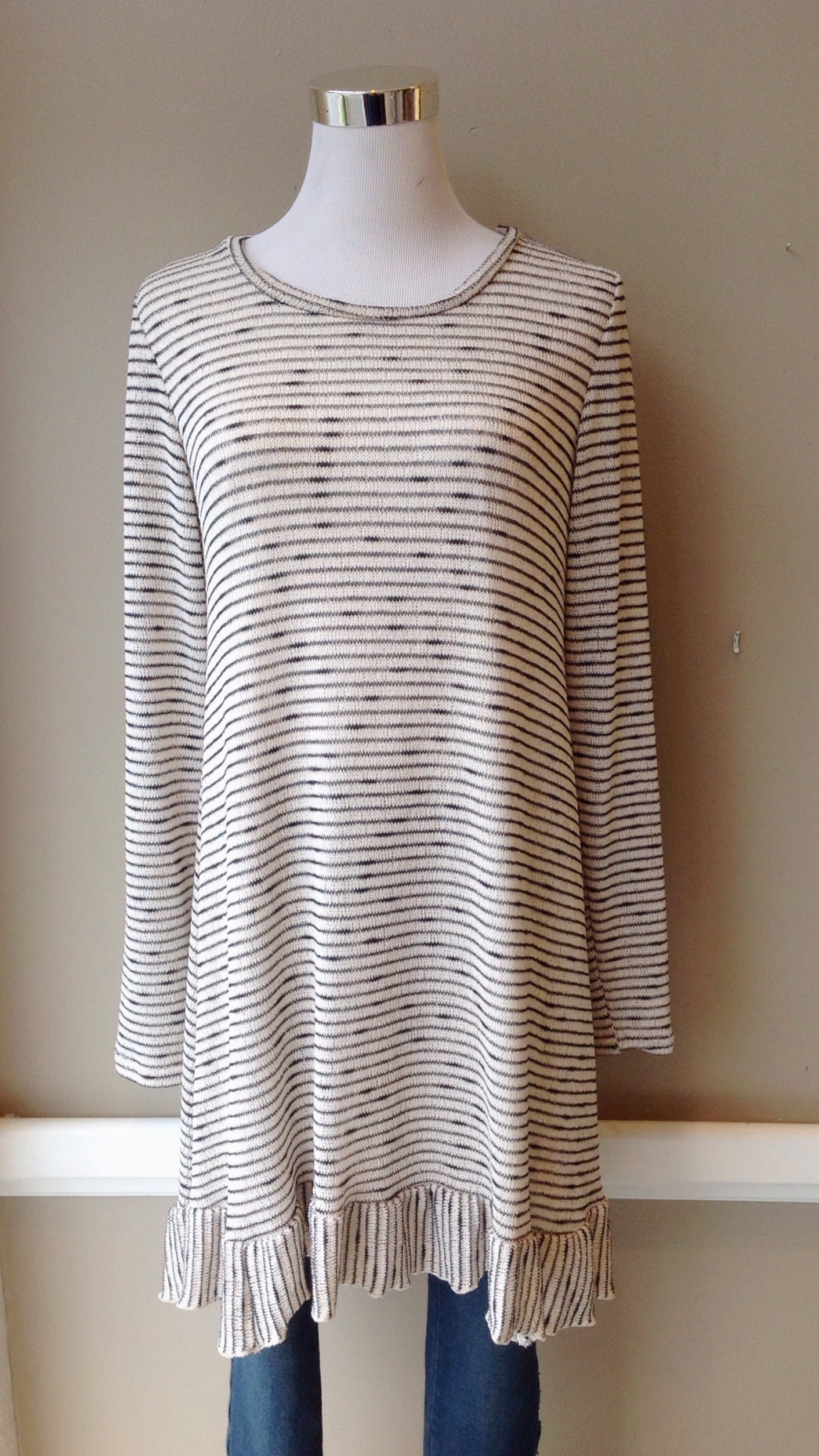 Stripe knit tunic with ruffle hem in cream/charcoal, $35