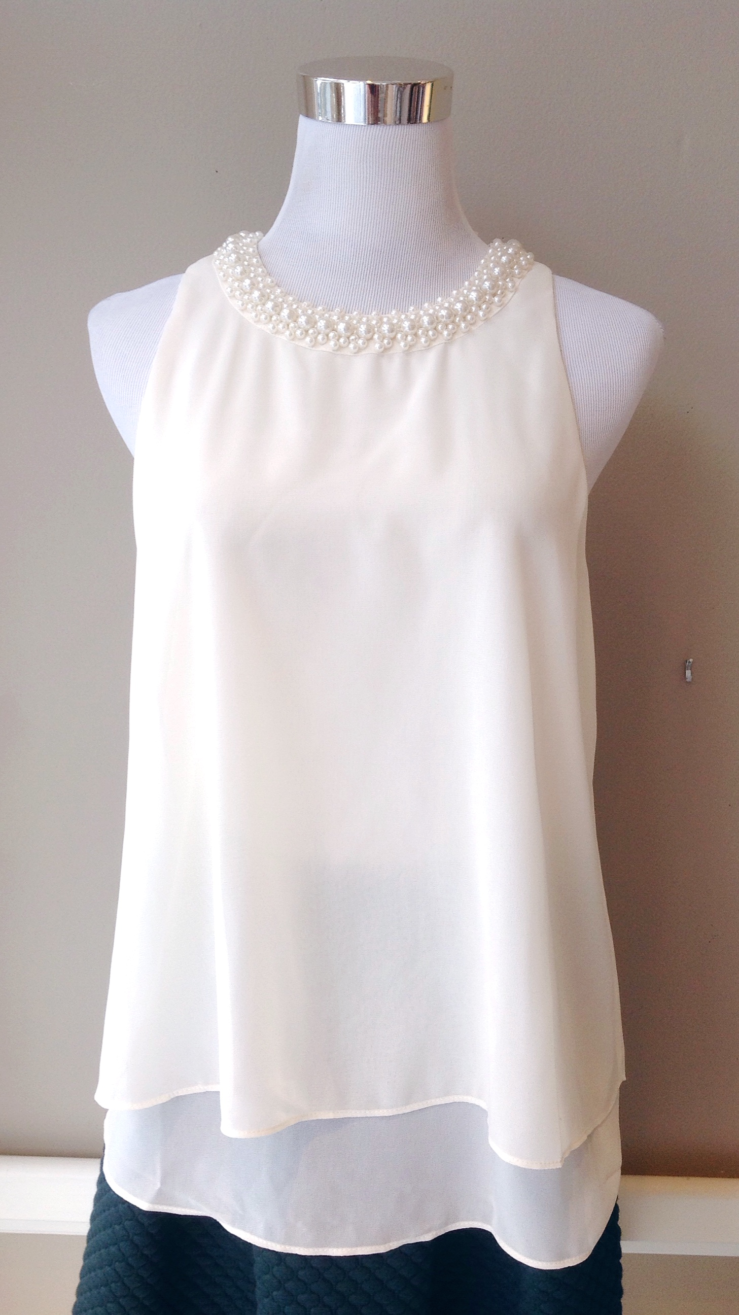 Layered poly chiffon tank with embellished collar and back pleat, $38