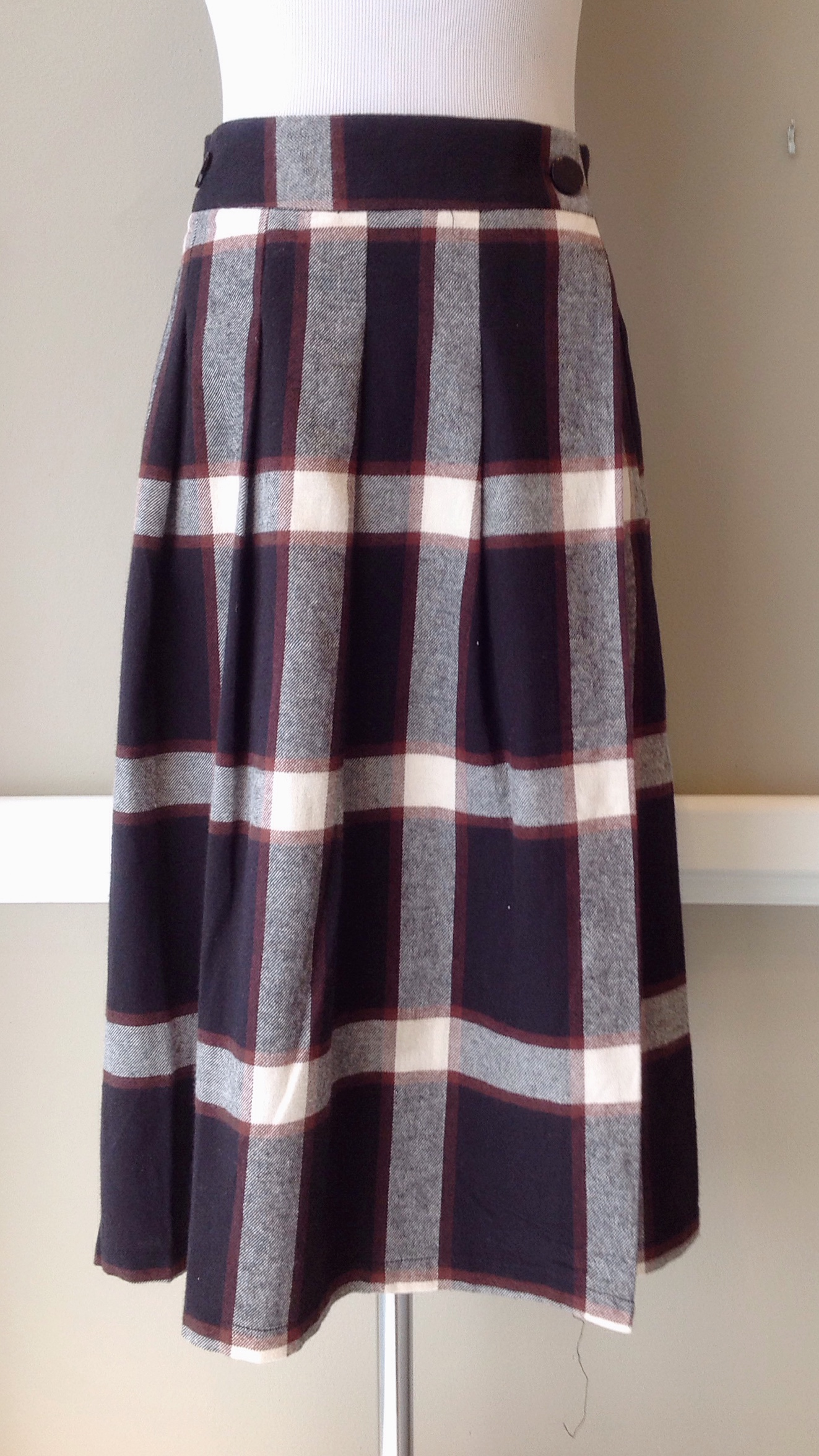Tartan plaid wrap skirt with front pleating, $35