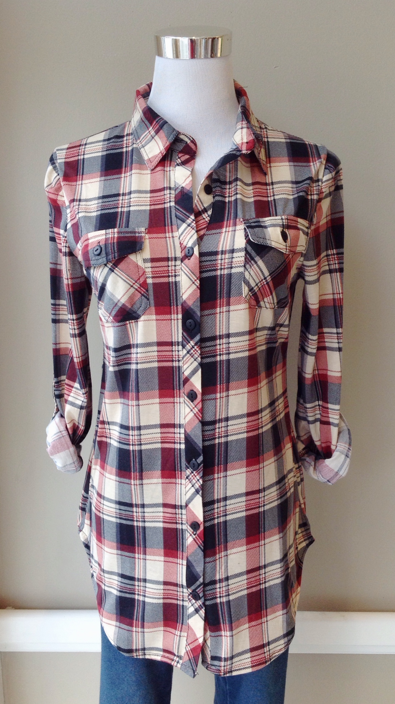 Button-down plaid top with roll tab sleeves in red/navy/taupe, $32