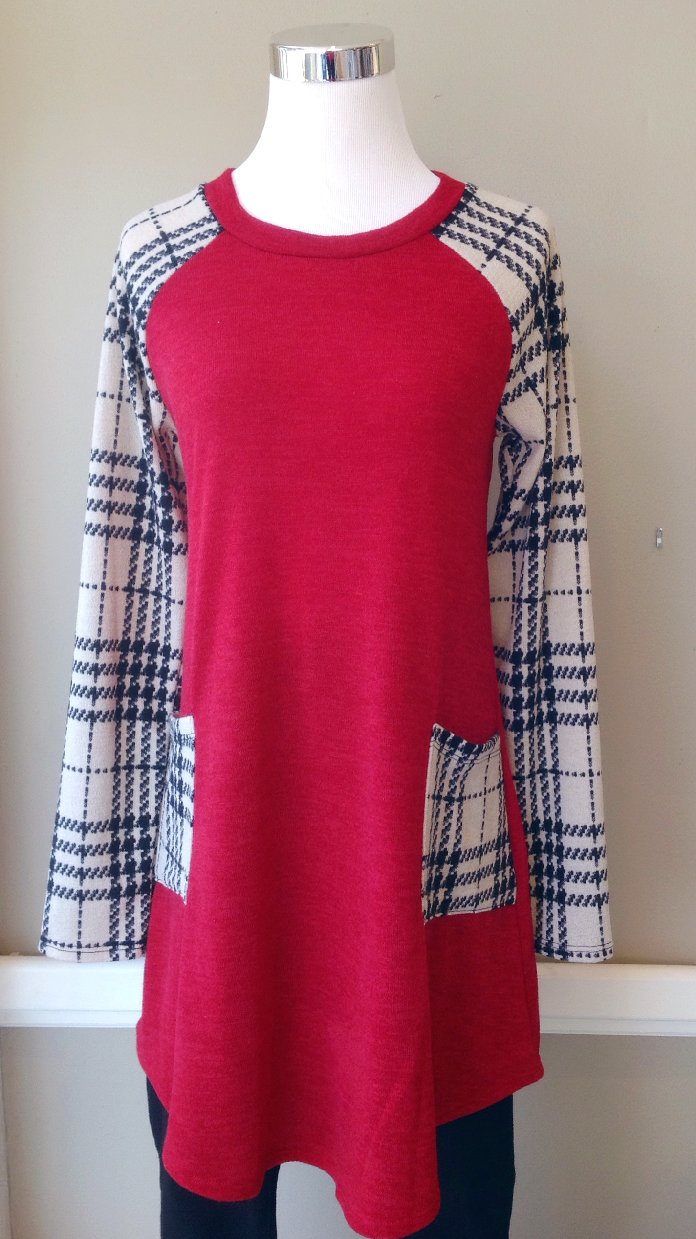 Red sweater tunic with contrasting plaid sleeves and patch pockets, $38