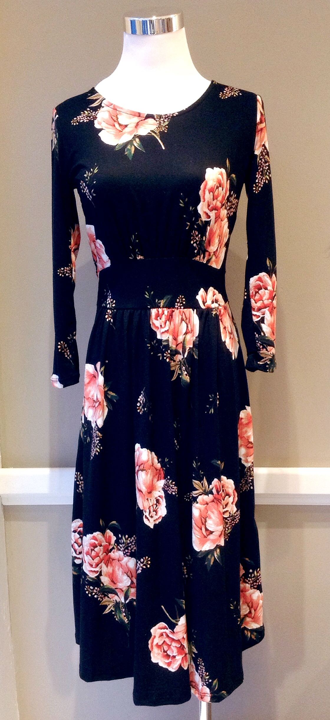 Knit midi dress with long sleeves and side pockets in black/pink floral, $38