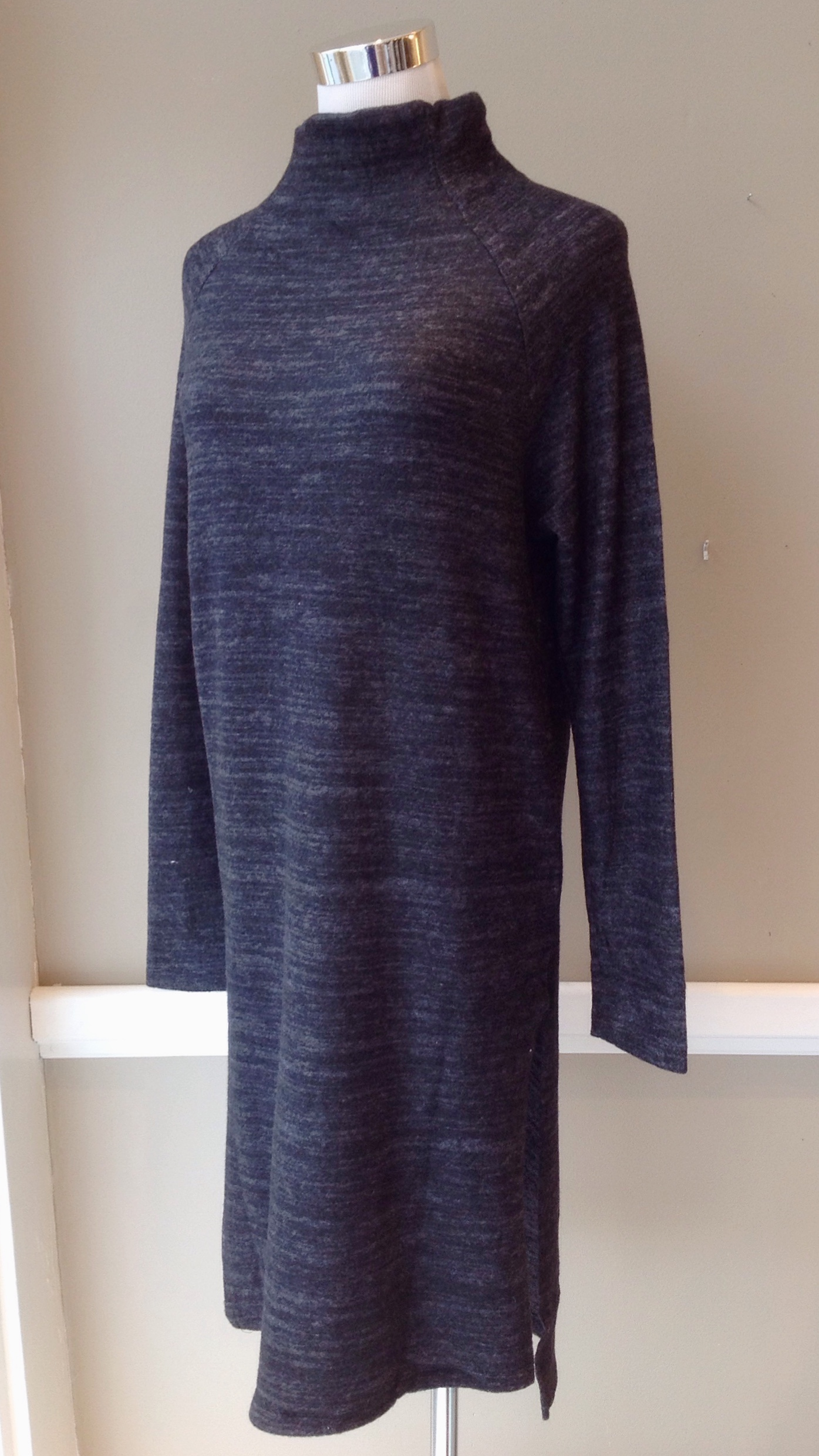 Two tone sweater dress with mock neck and side slits in black/charcoal, $45