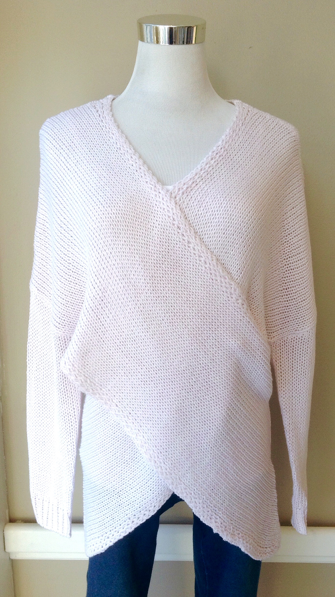 Cross front knit sweater in pale pink, $38