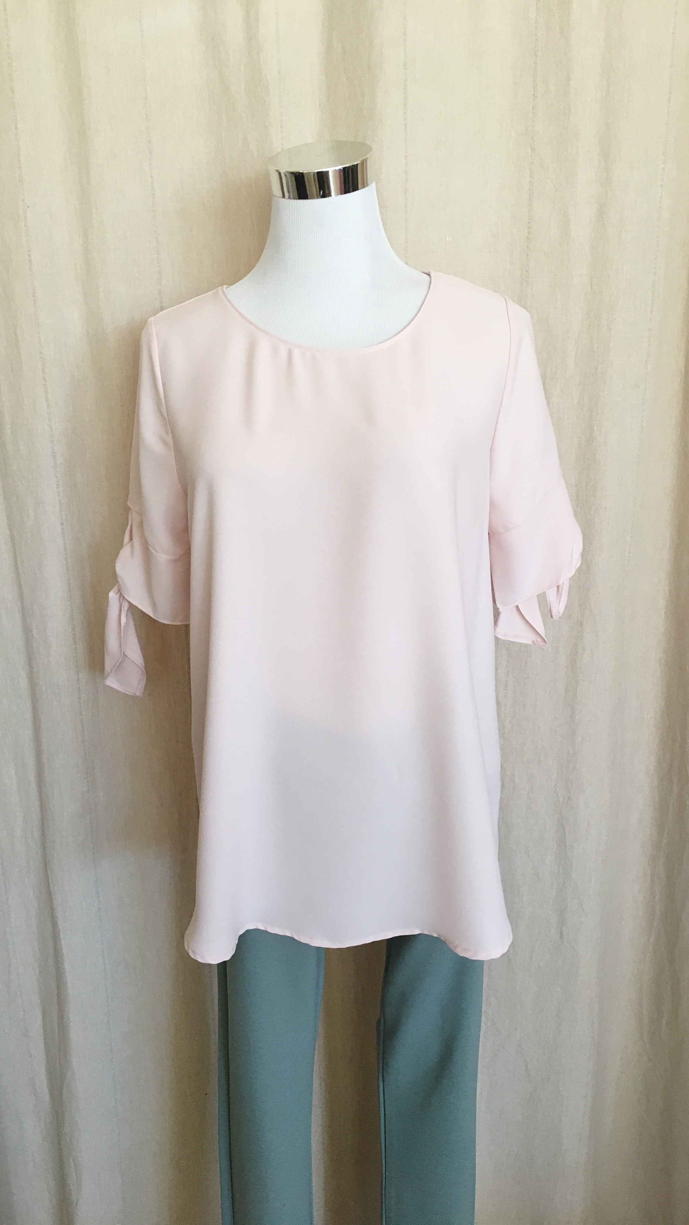 Blush top with romantic tie sleeves. $32
