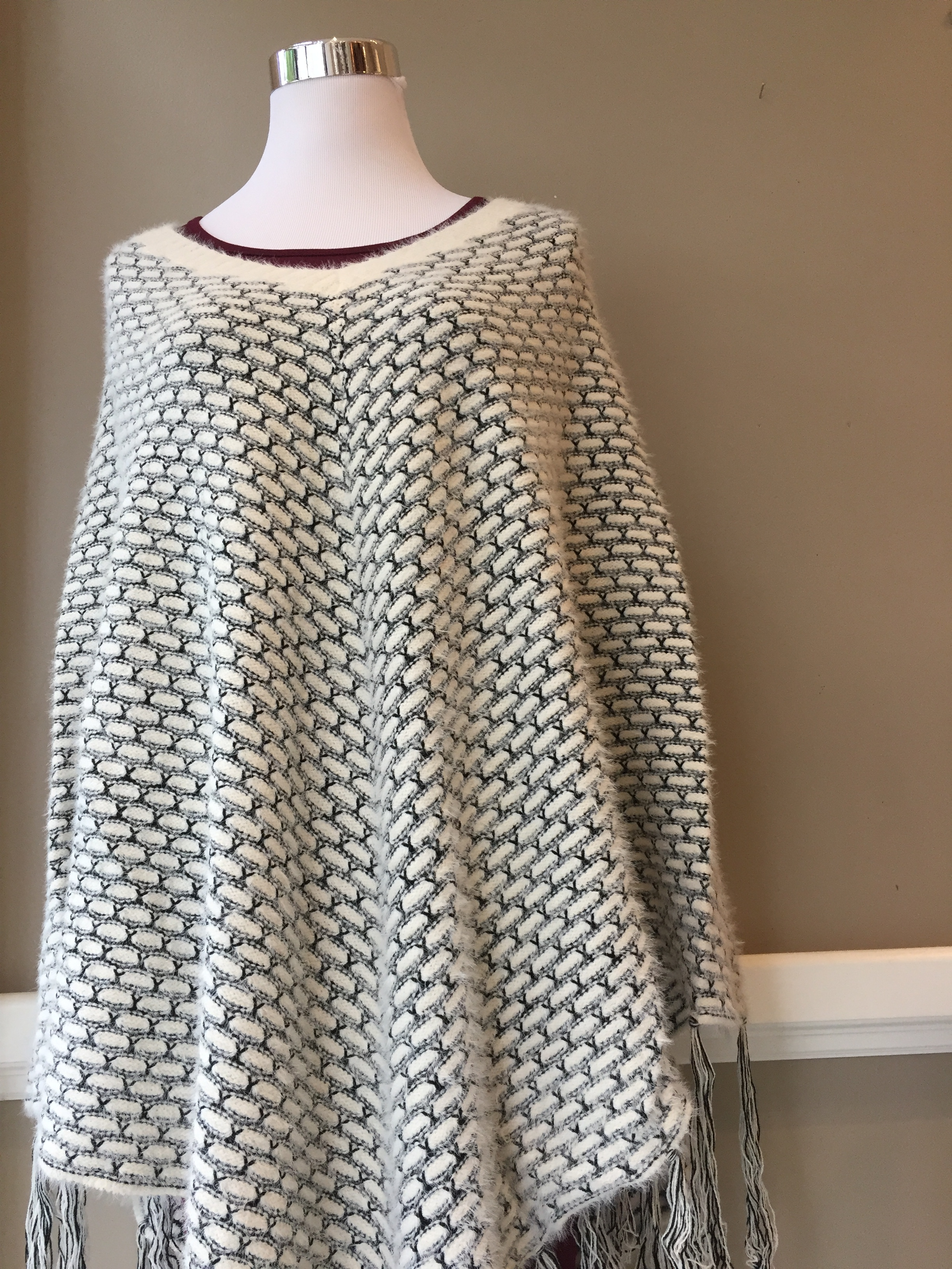 Black and white poncho ($38, also in navy)