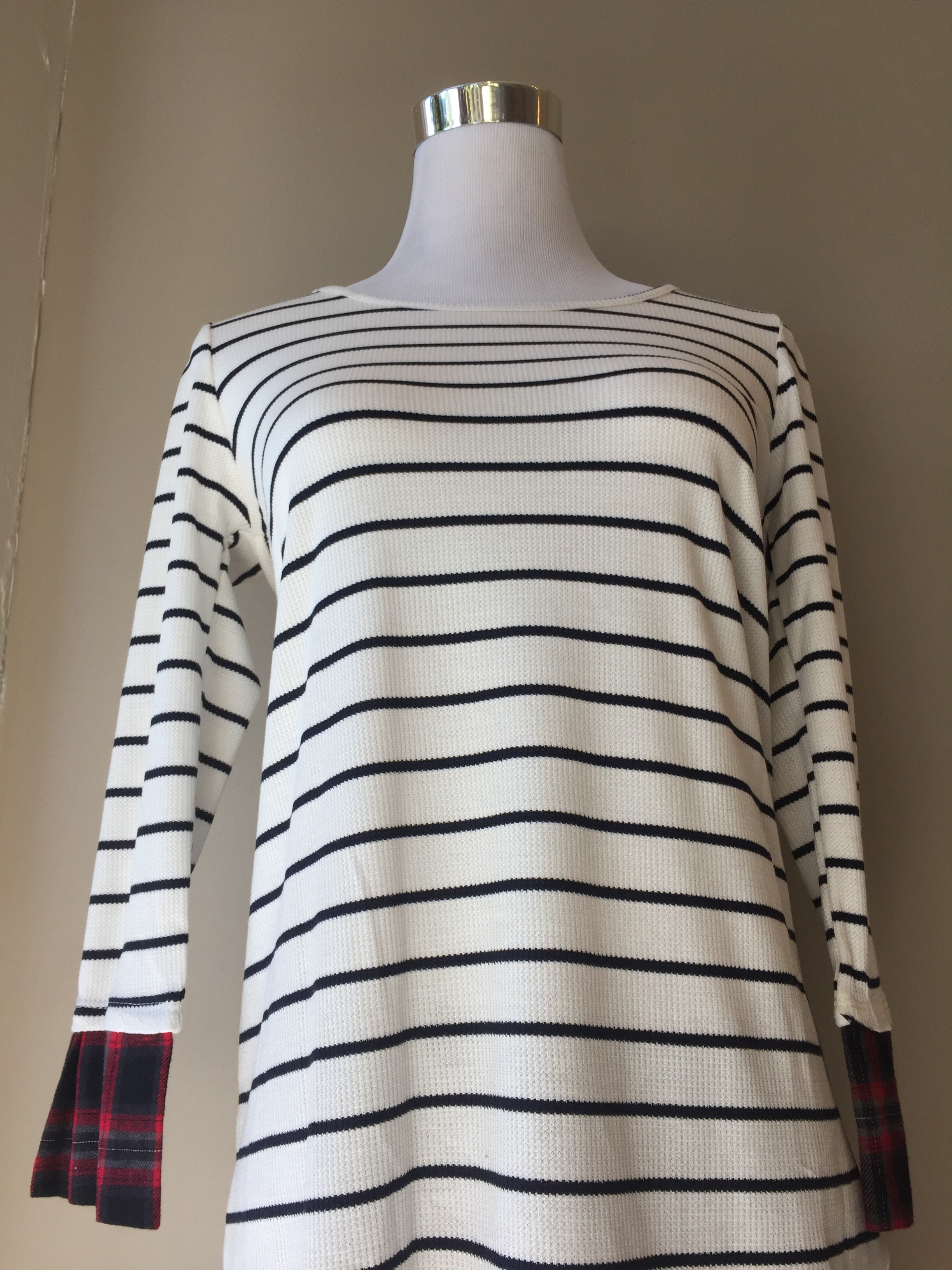 Striped top with plaid cuffs ($34)