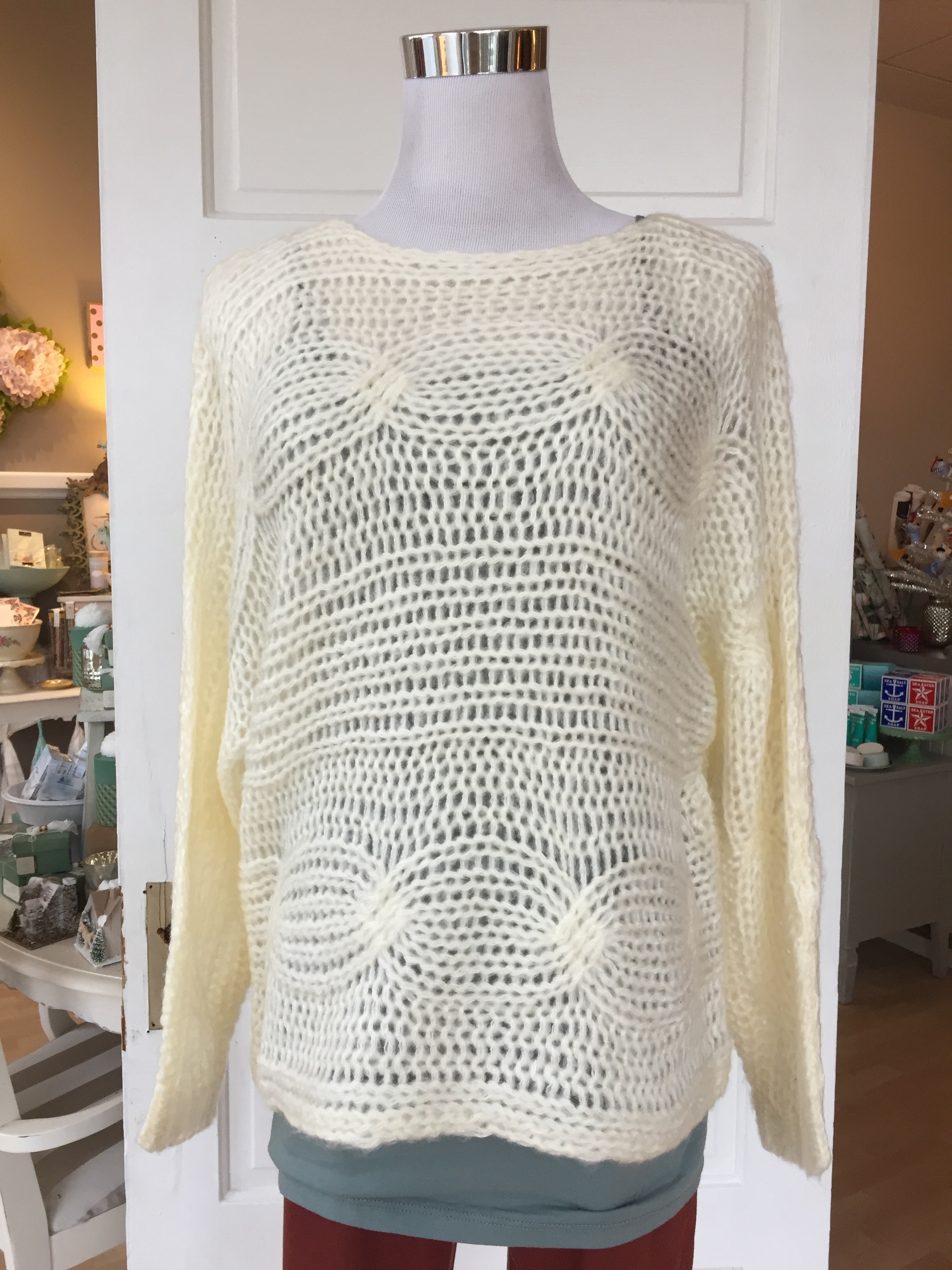 Ivory knit sweater ($38)