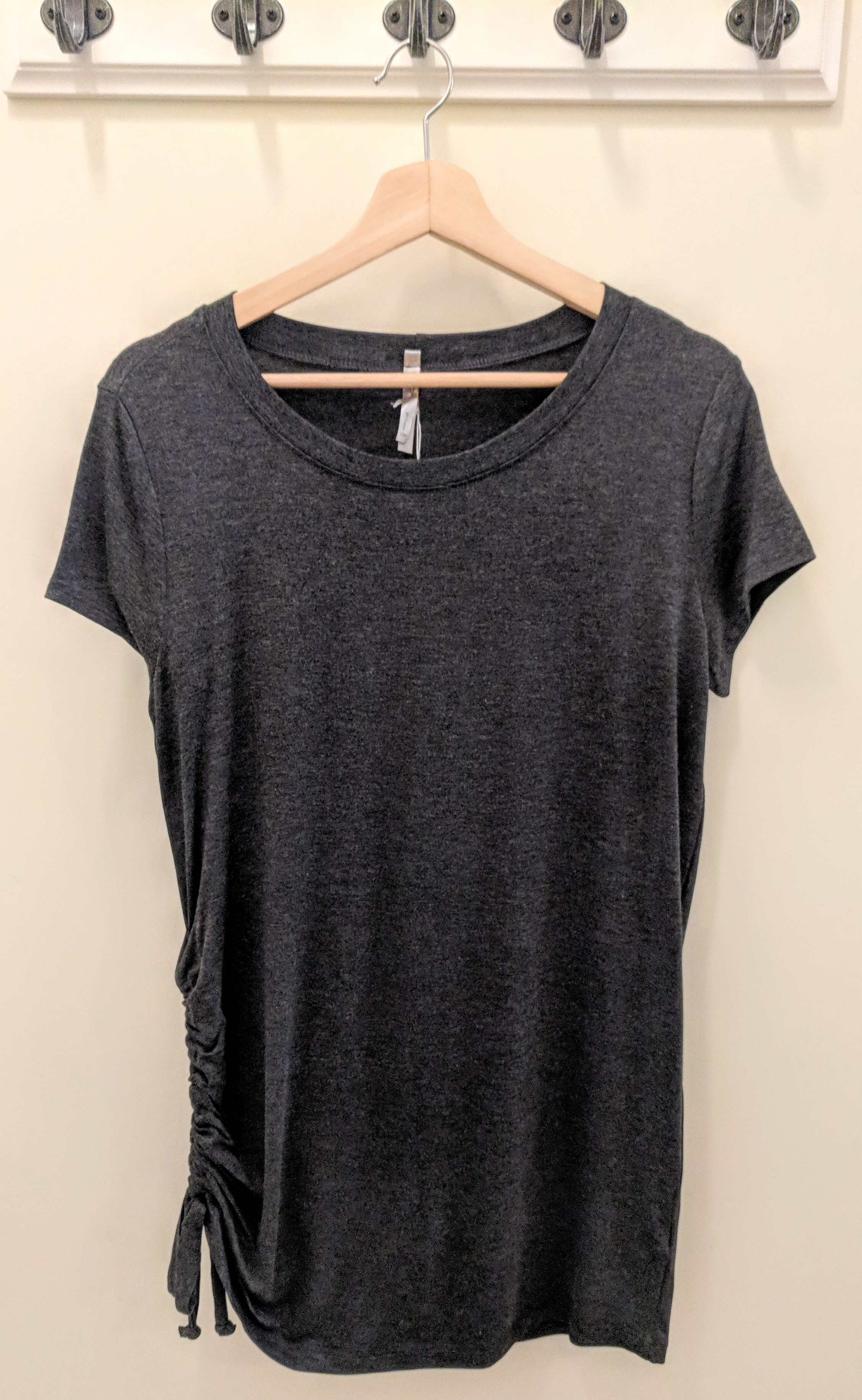 Charcoal knit tunic with adjustable drawstring on side. $28