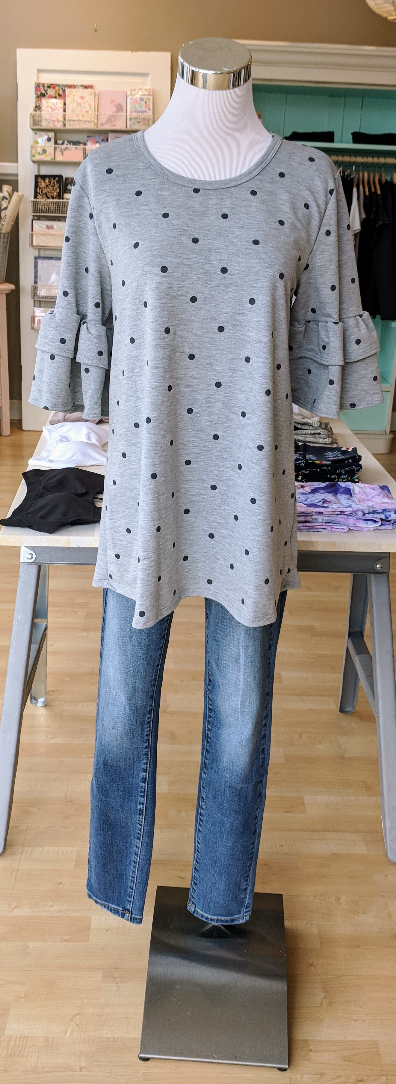 Grey polka dot top with bell sleeves $34