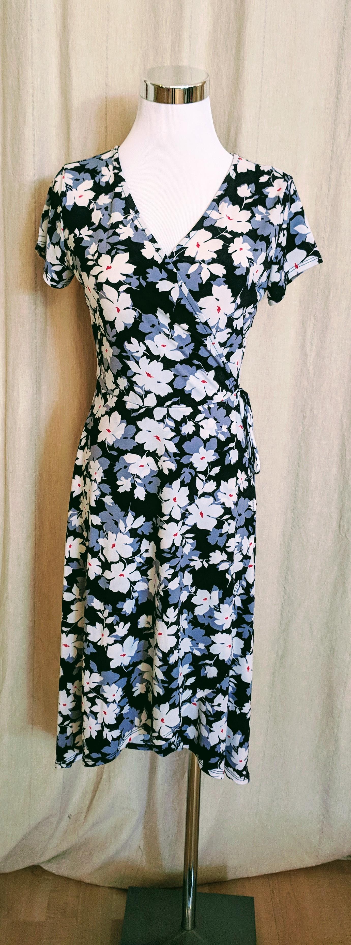 Black floral faux wrap midi dress. $52
