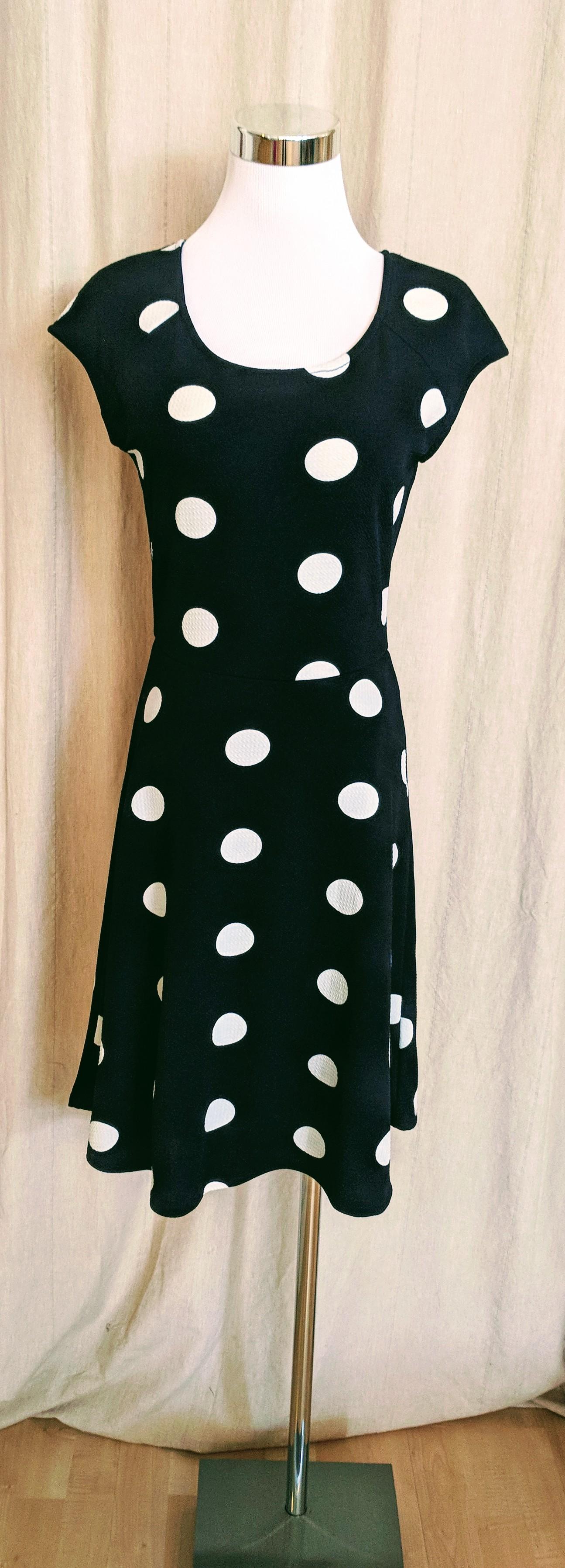 Navy A-line polka dot dress. $42