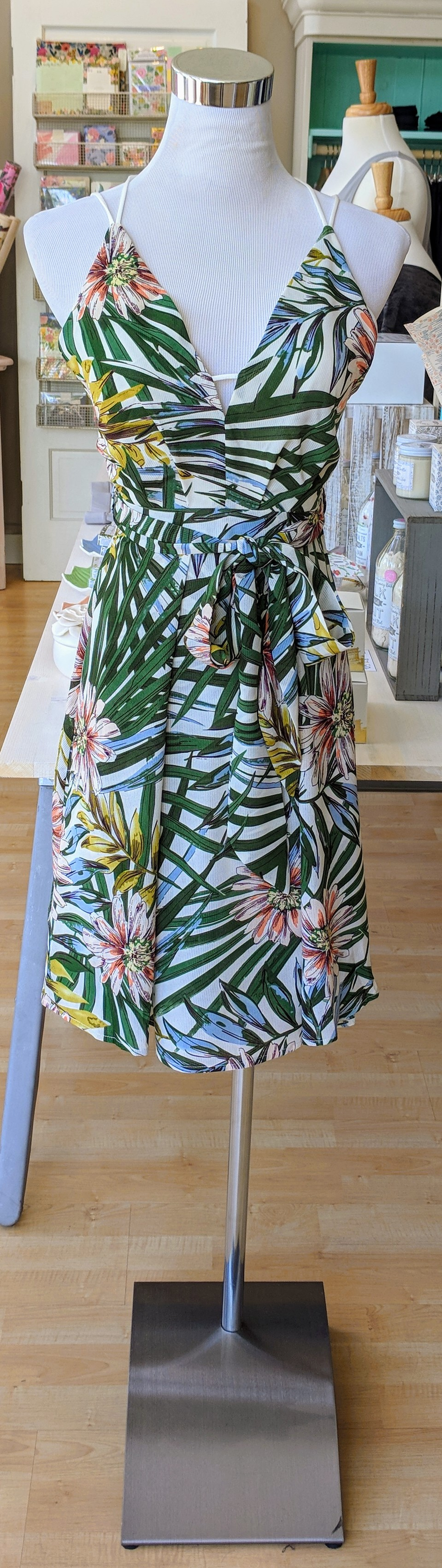 Tropical mini dress with X-strap on back.