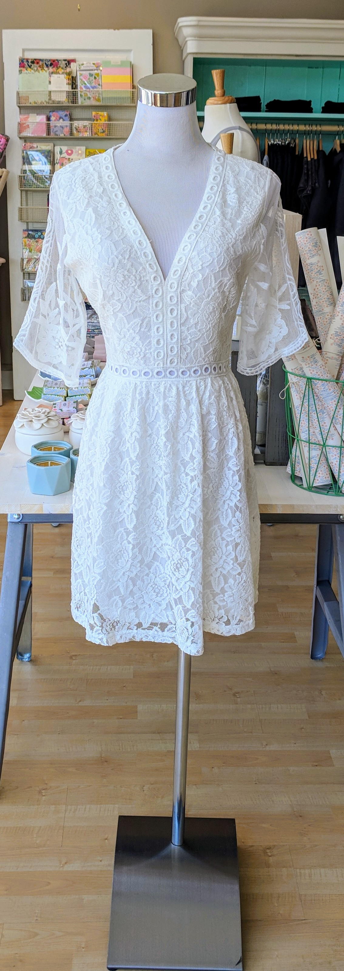 Off White crochet dress with bell sleeves.