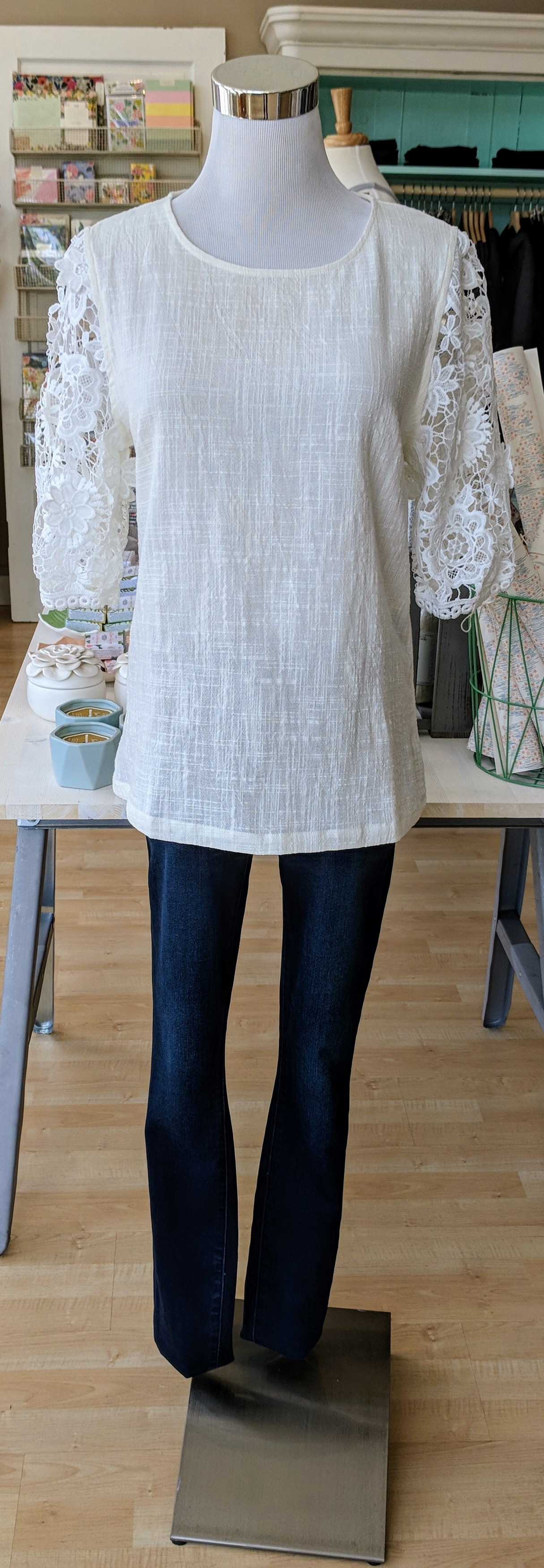 Ivory woven top with floral lace sleeves.
