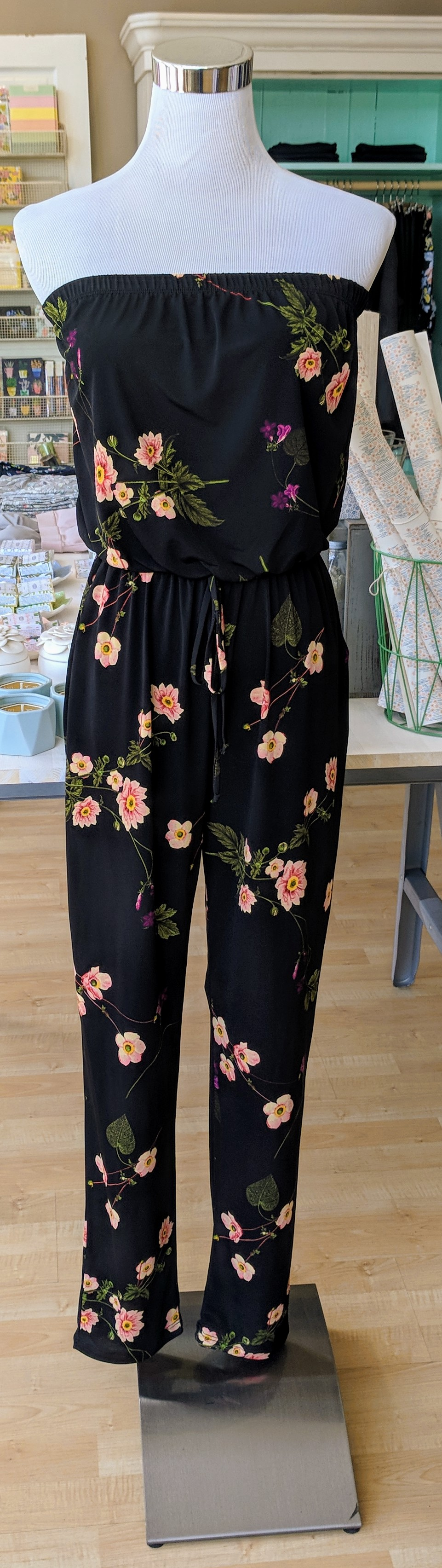 Black floral strapless jumpsuit with pockets.