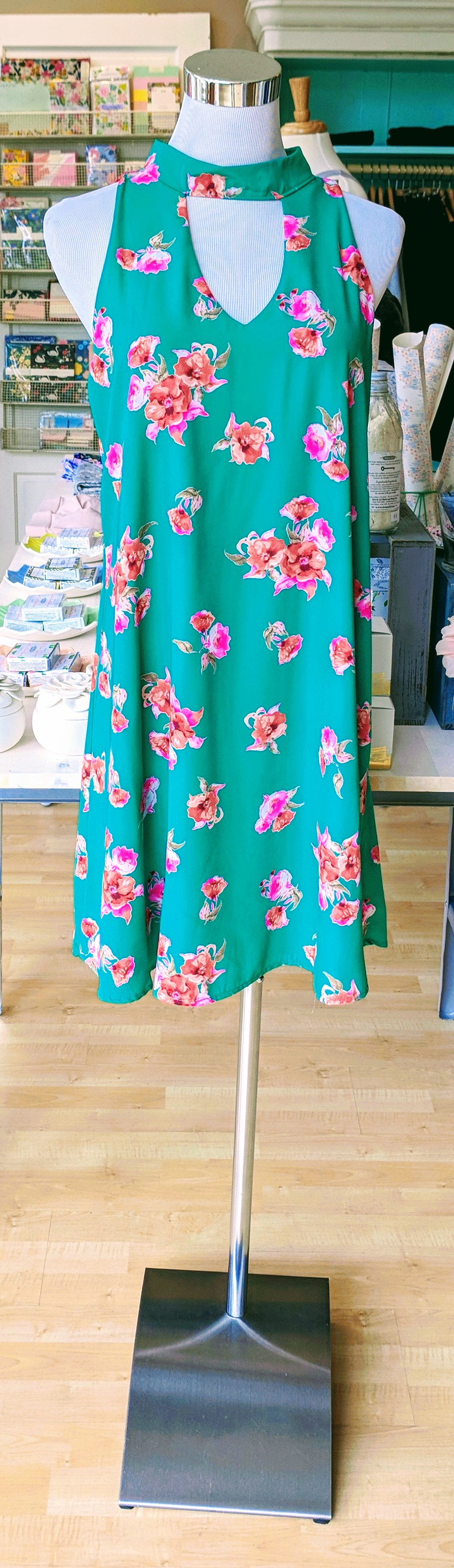 Green floral dress with key hole detail on front and back.
