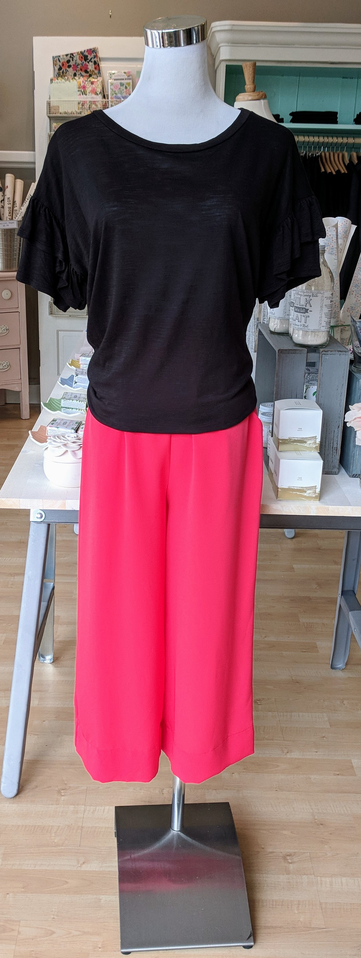 Coral Culotte pant with Black ruffle sleeve top.