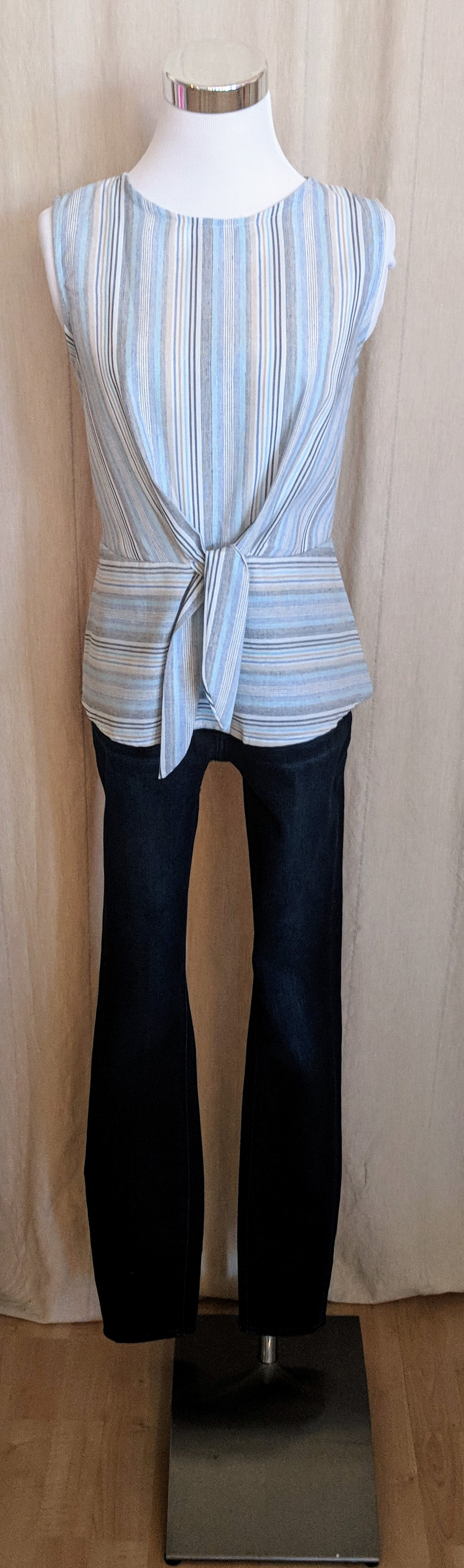 Blue and white stripe tank top with tie detail on front.