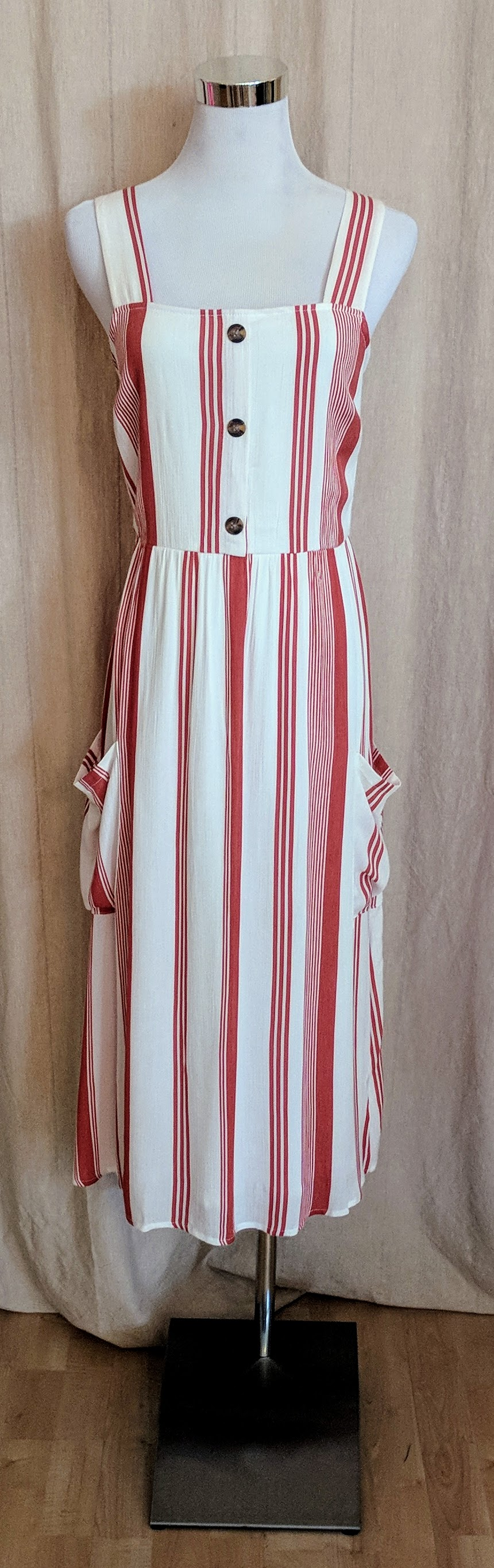 White and orange striped midi dress with buttons.