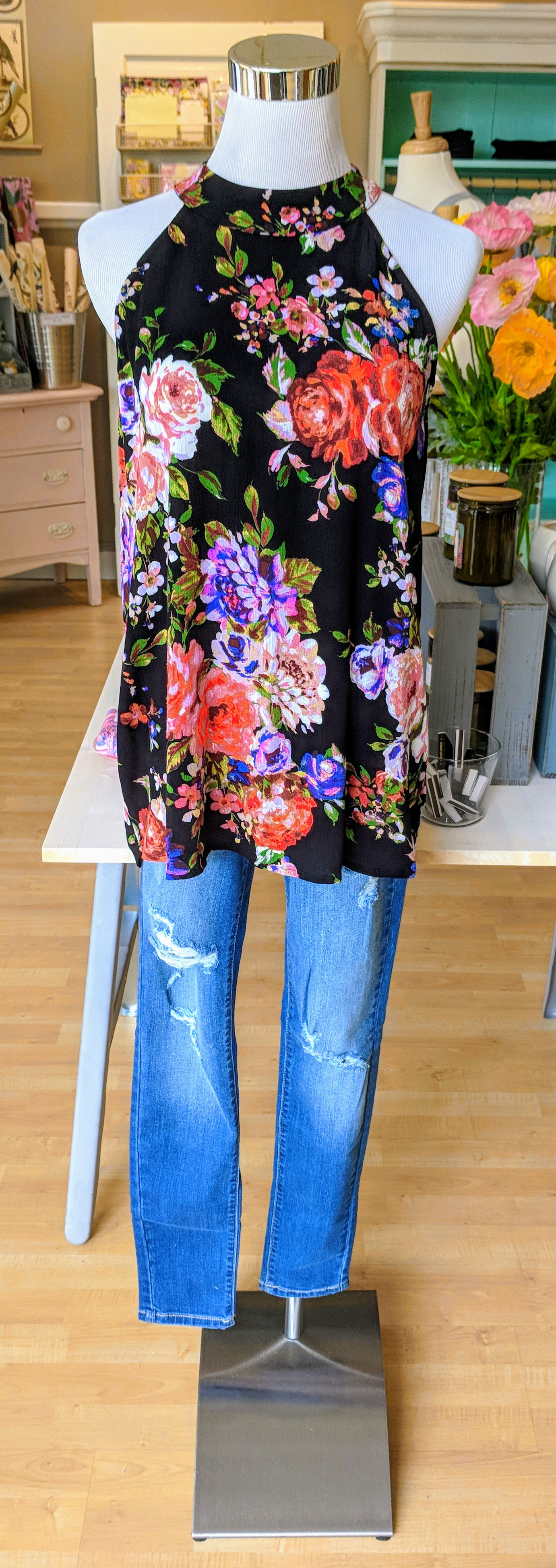 Black floral high low hem tunic with key hole detail on back.