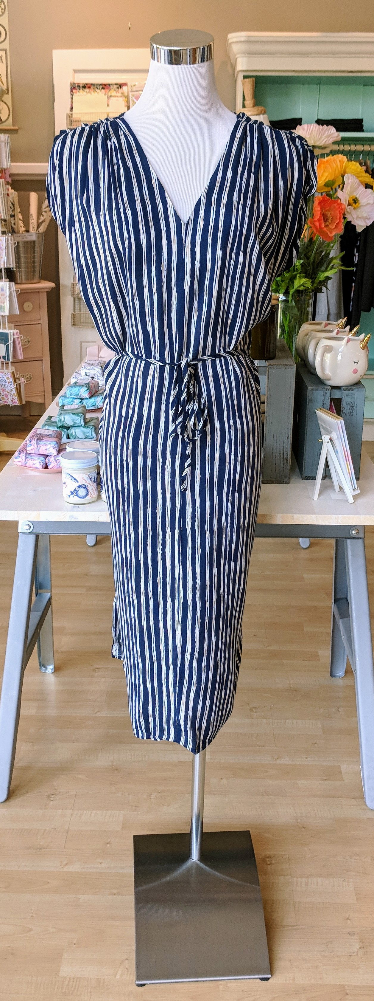 Blue pleated midi dress with tie front.