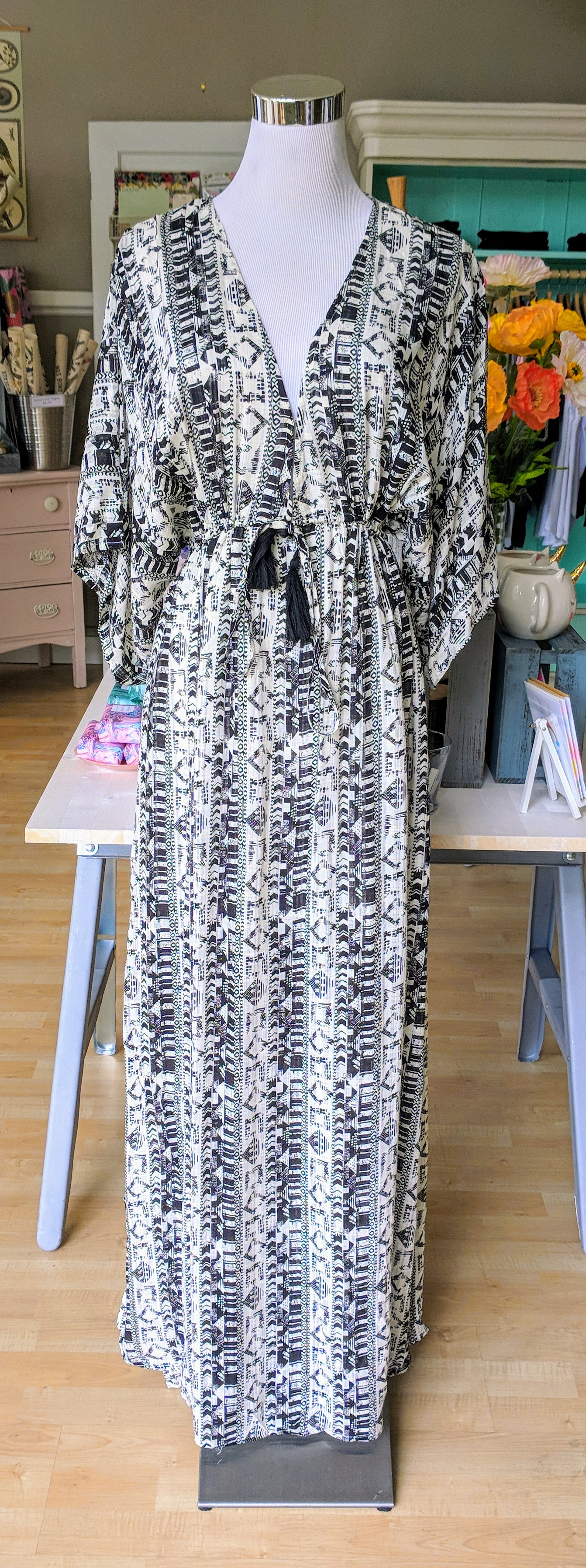 Black and white Aztec print maxi dress with tie tassels on waist.