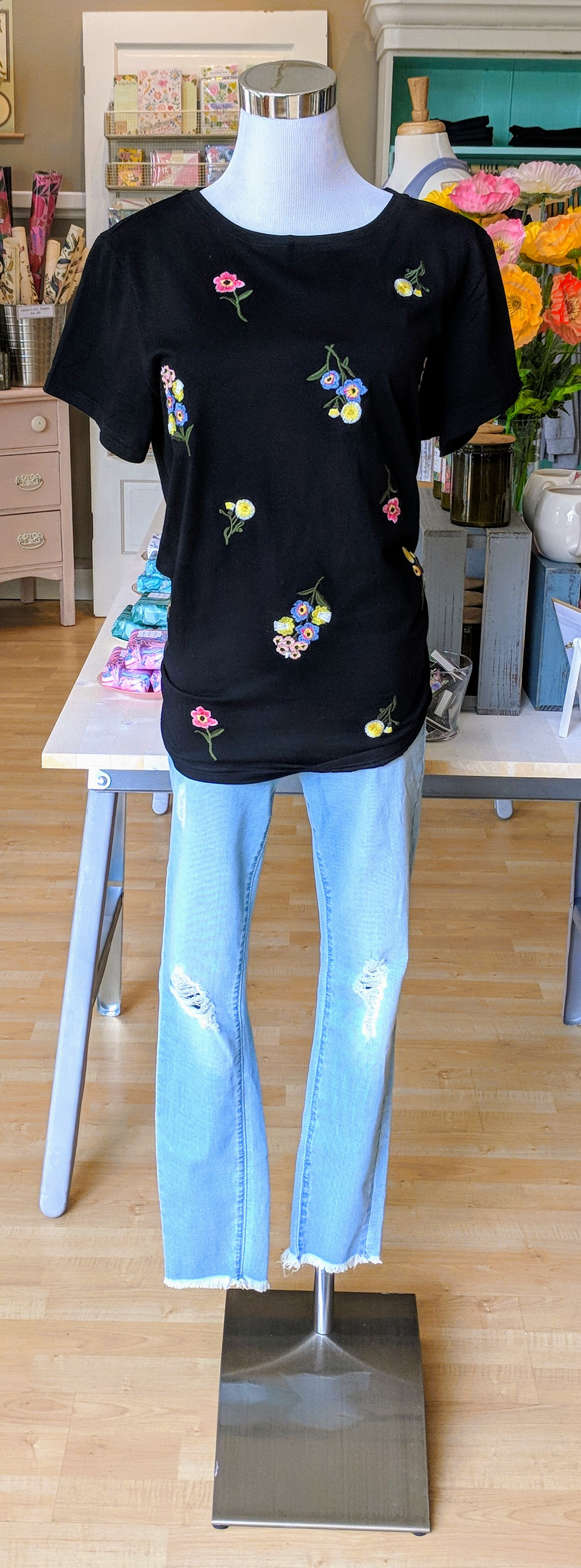 Black floral top with embroidered detail.