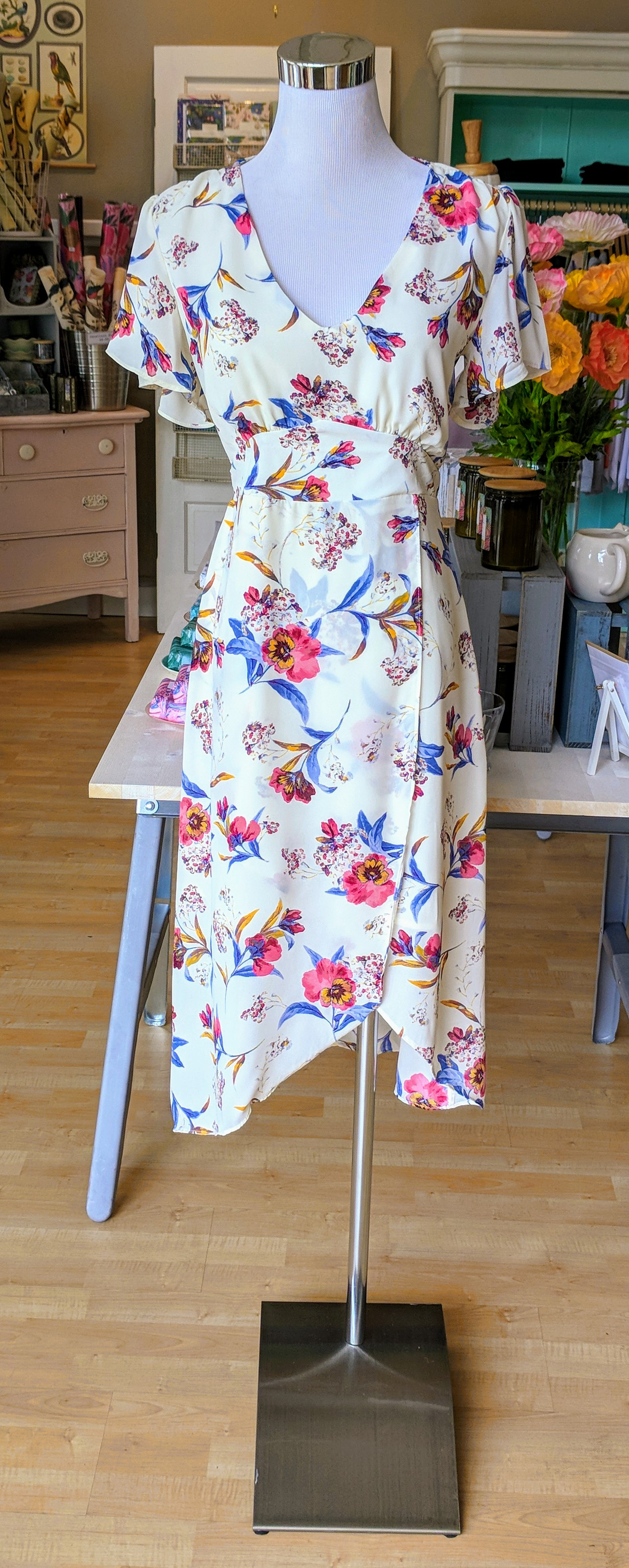 Ivory and Pink floral midi dress with an empire waistband.