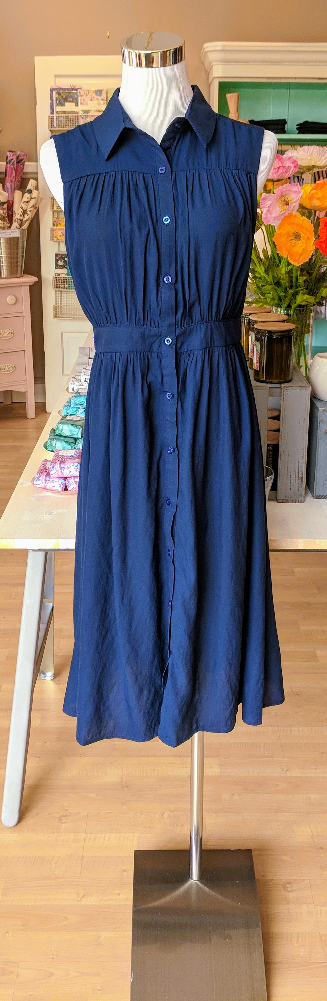 Navy collared midi dress with button up front.