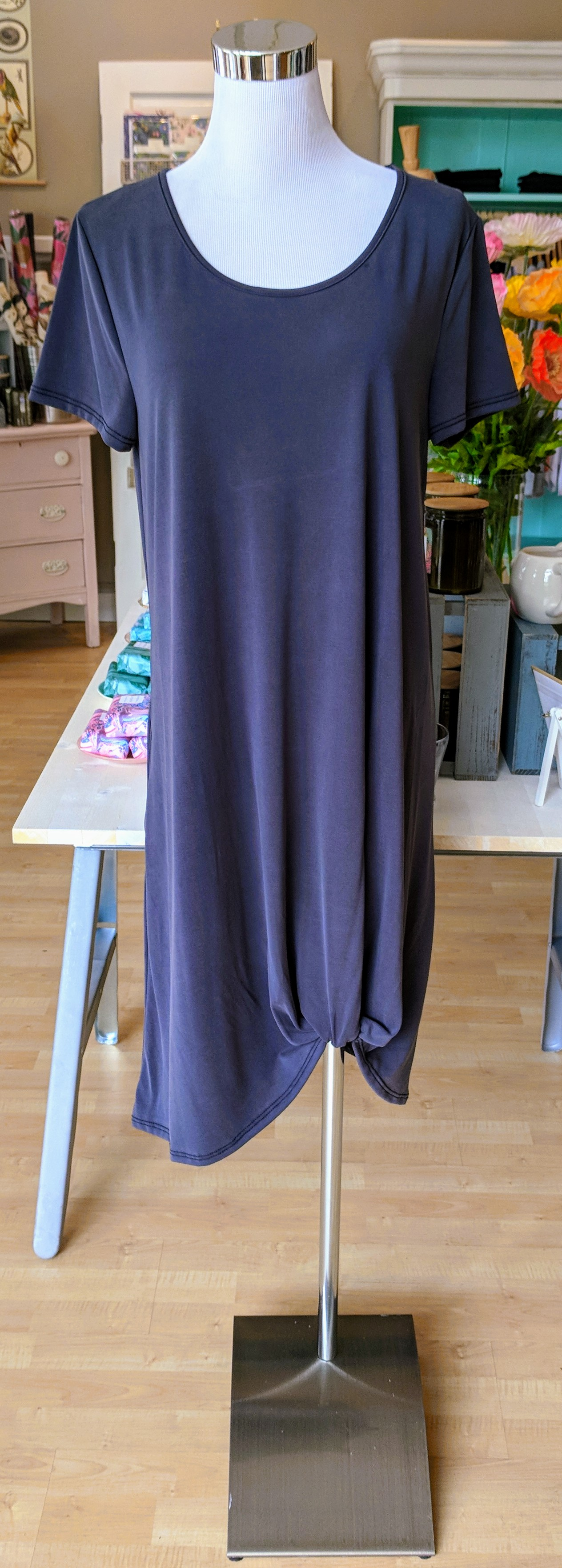 Charcoal knit dress with knotted hem.