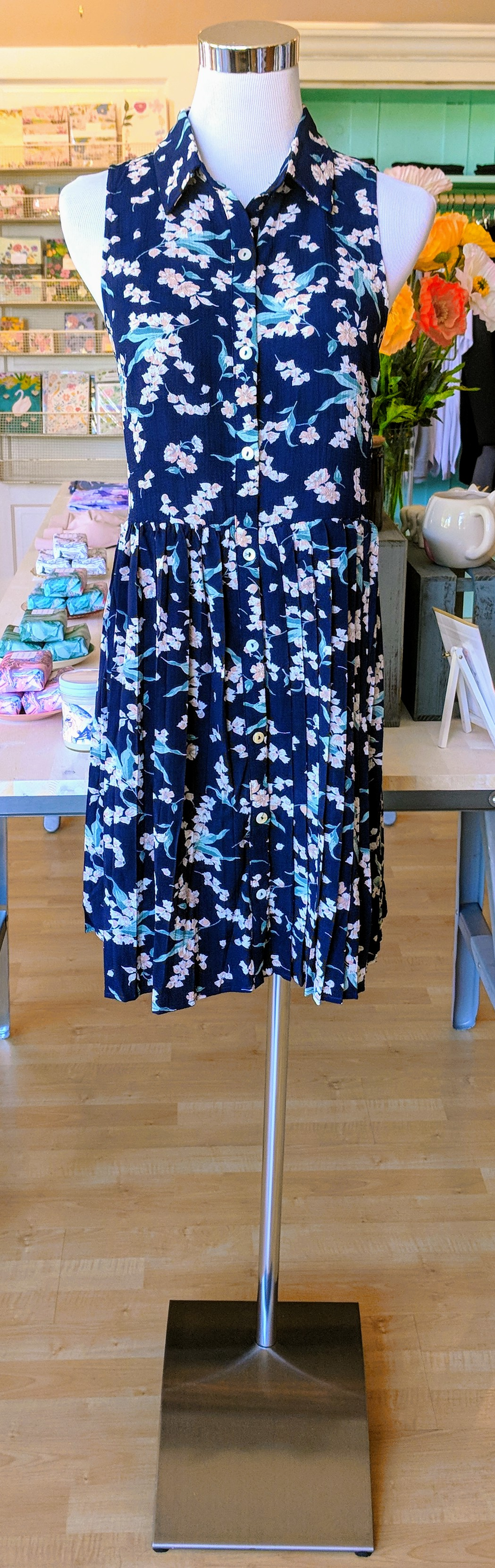 Navy floral dress with pleated bottom.