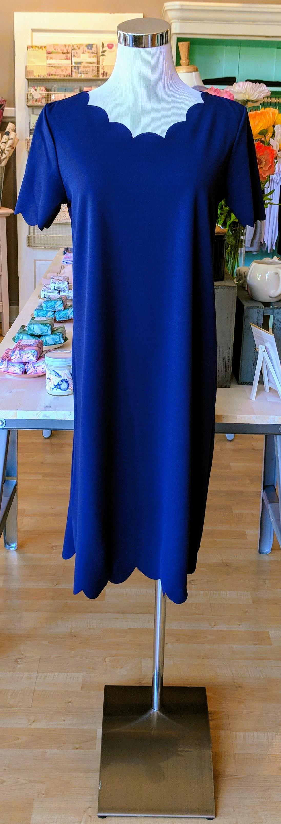 Navy dress with scallop hem