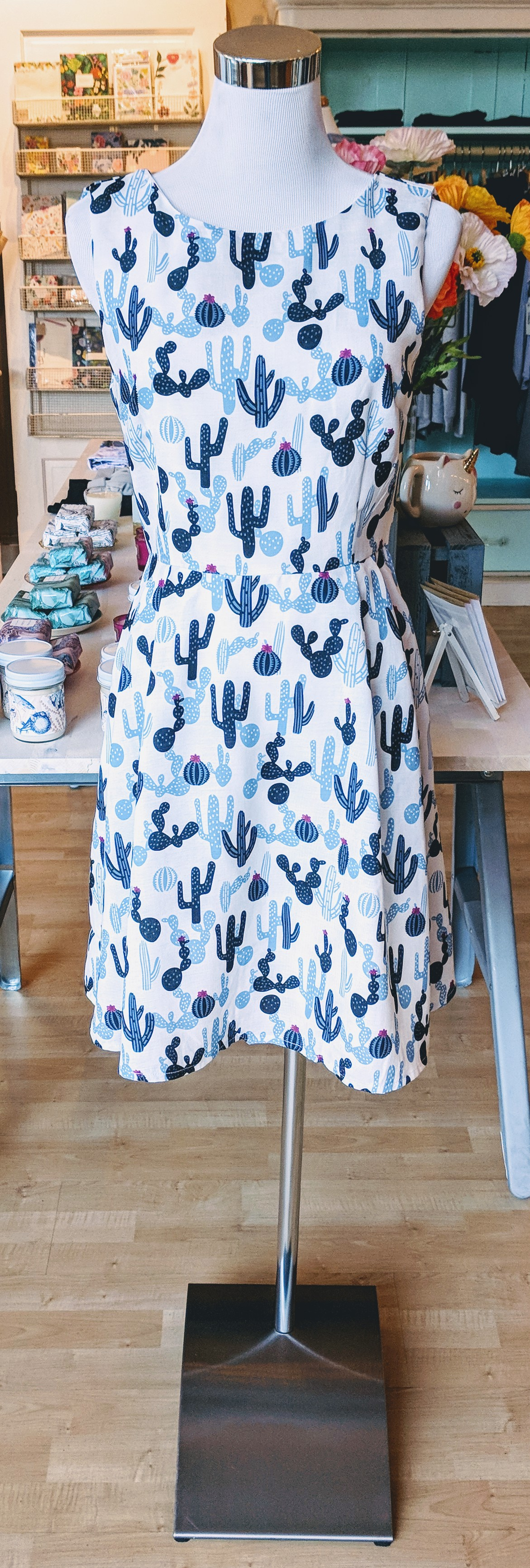 Simple blue cactus print dress with pockets.