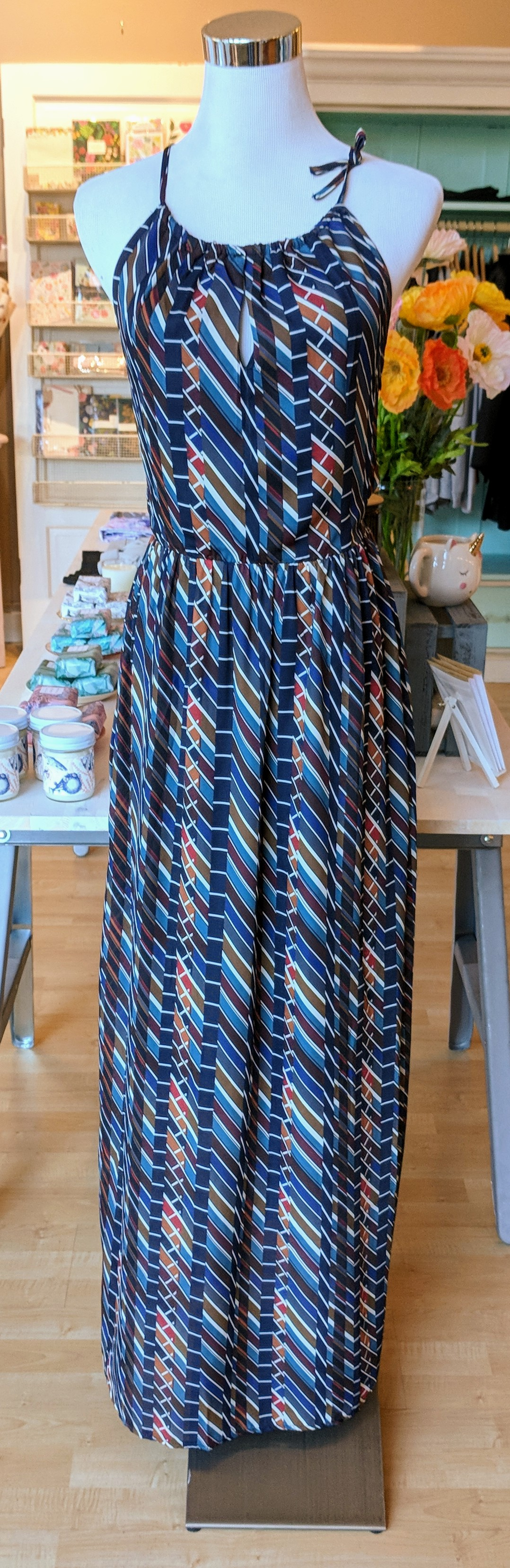 Multi color print dress with tie neckline.