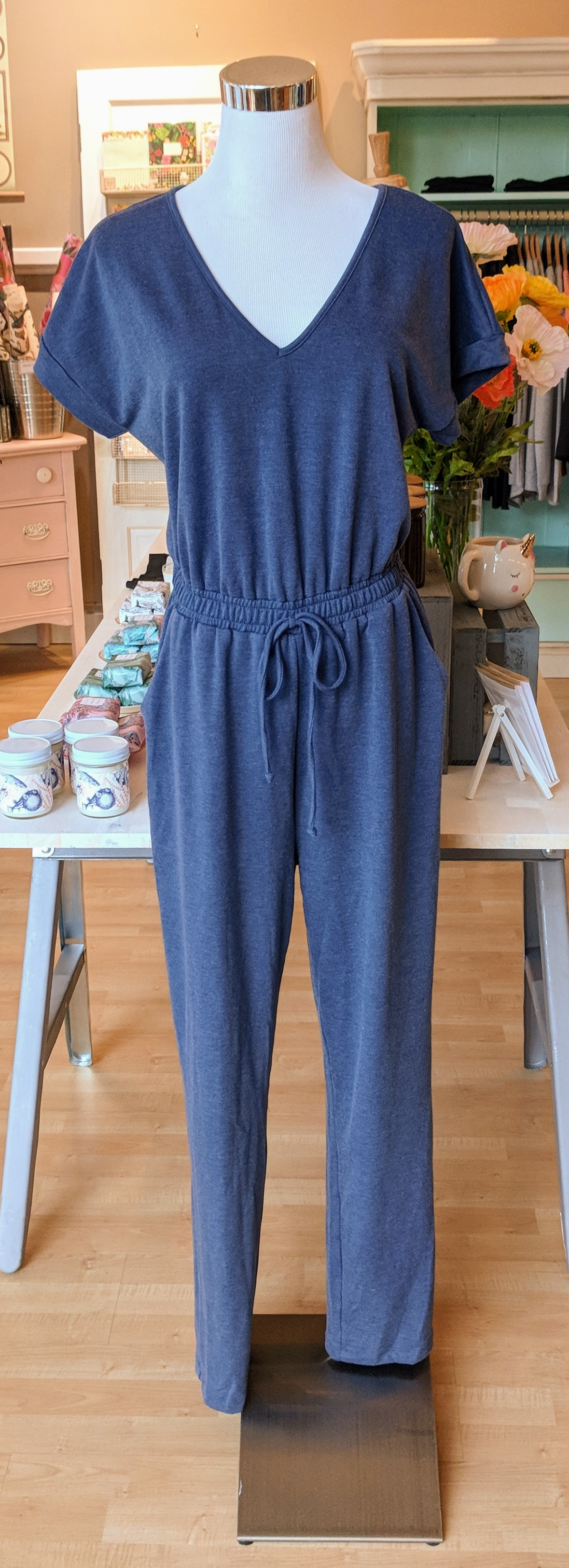Denim blue jumpsuit with tie waistband