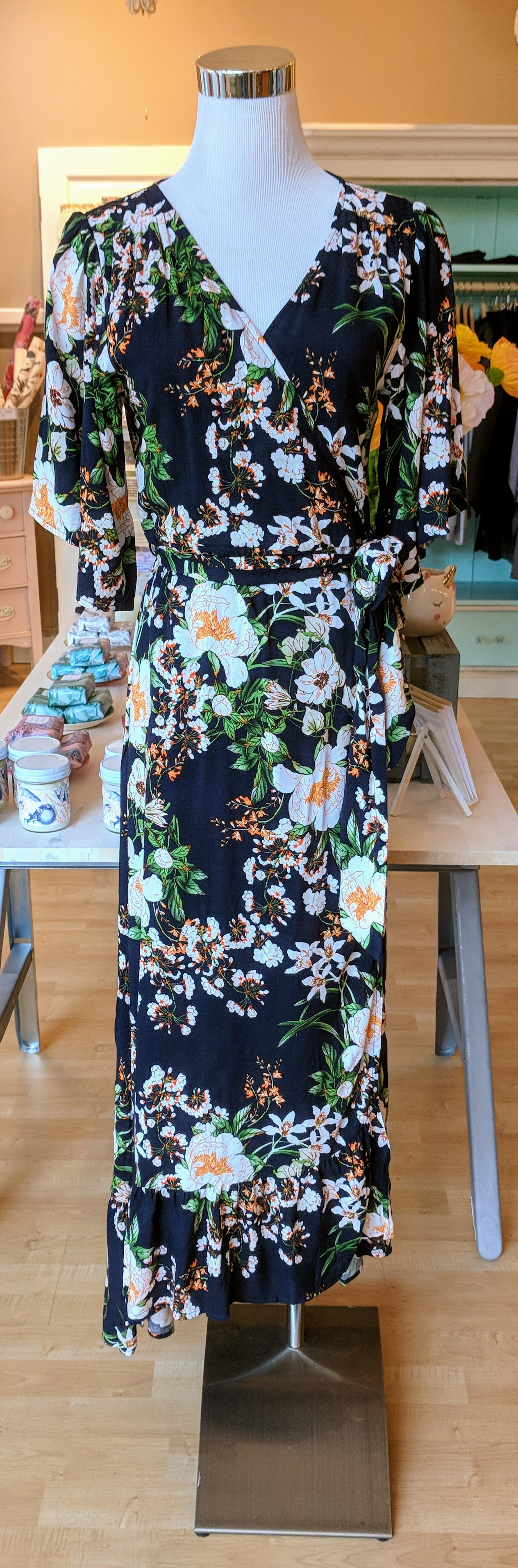 Navy floral wrap dress with hi-low ruffle hem and tie waistband.