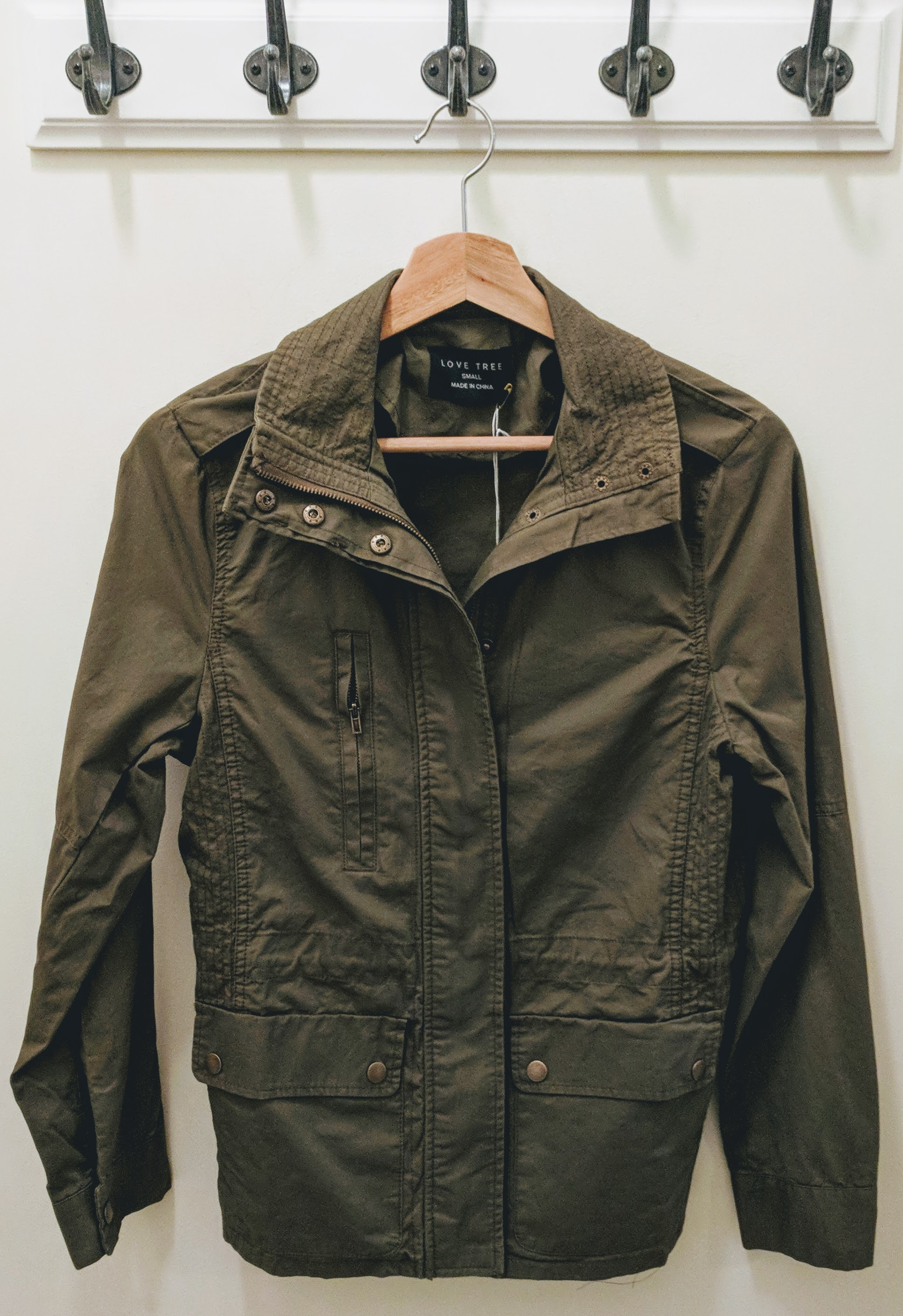Olive utility jackets with elastic adjustable waistband.