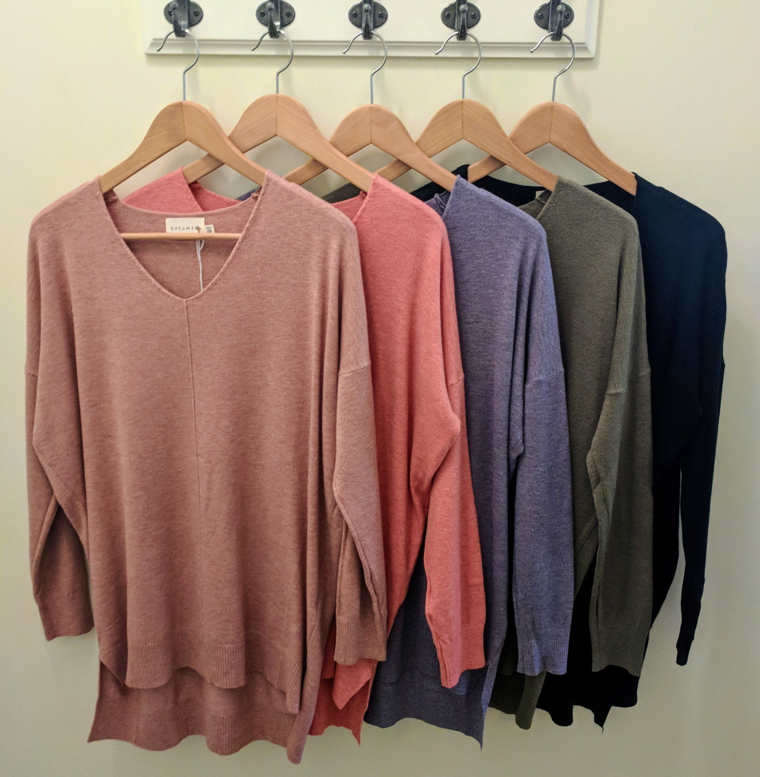 Dusty Rose, Coral, Dusty Blue, Olive, and Black dreamer sweater.