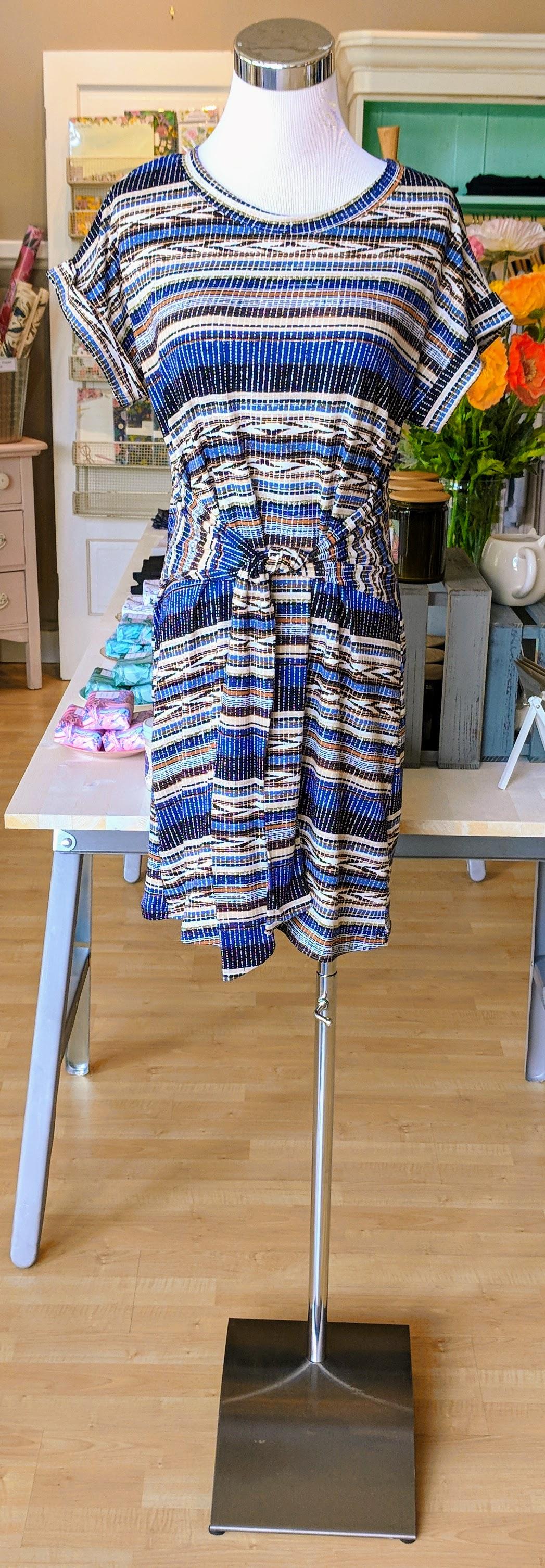 Blue multi pattern midi dress with tie waist accent.