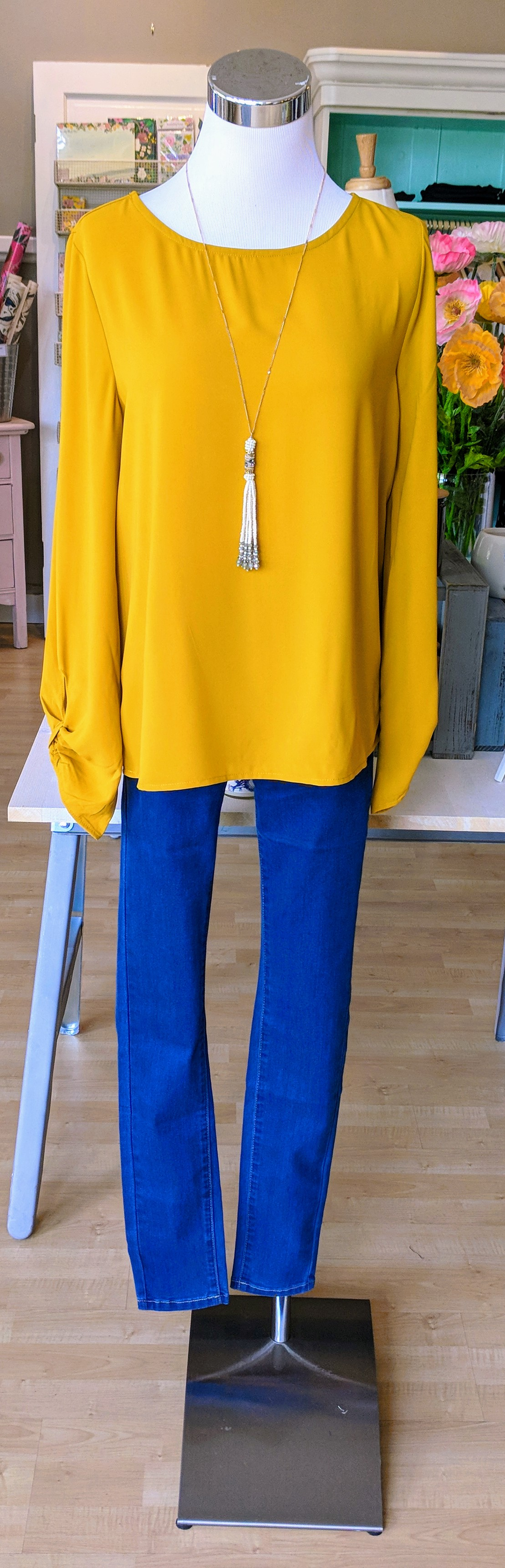 Mustard yellow long sleeve top paired with new Kancan high waist denim.