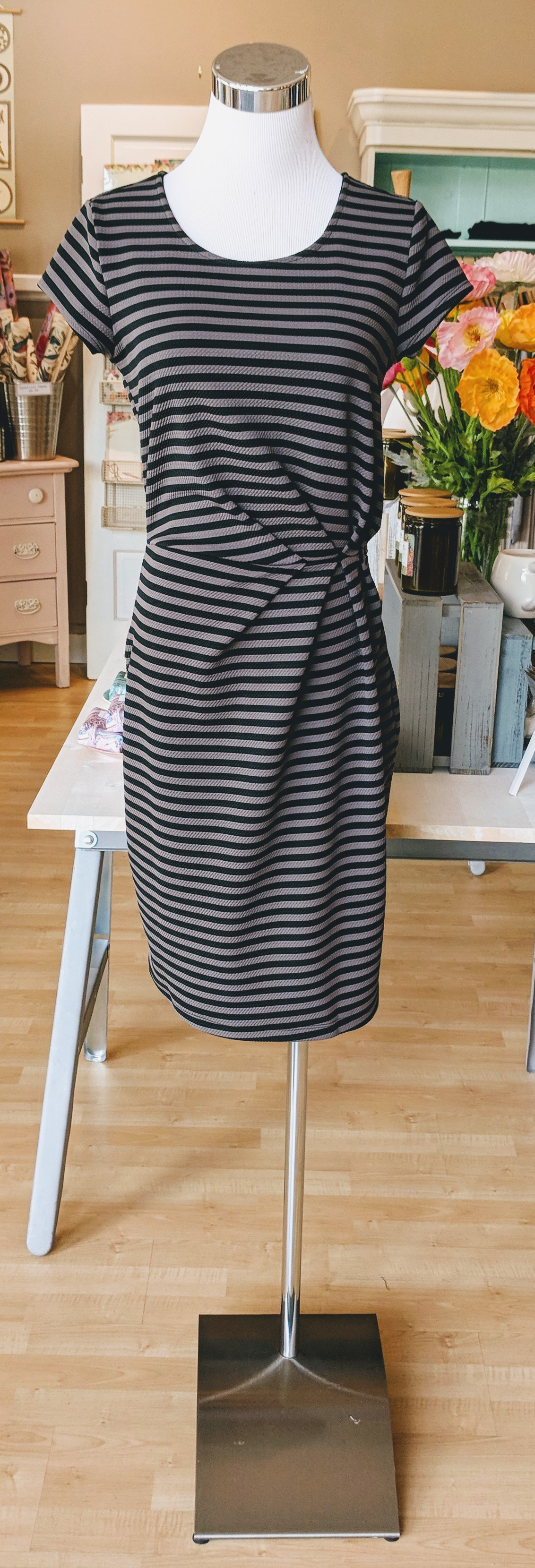 Grey and black stripe mini dress with side cinch detail.