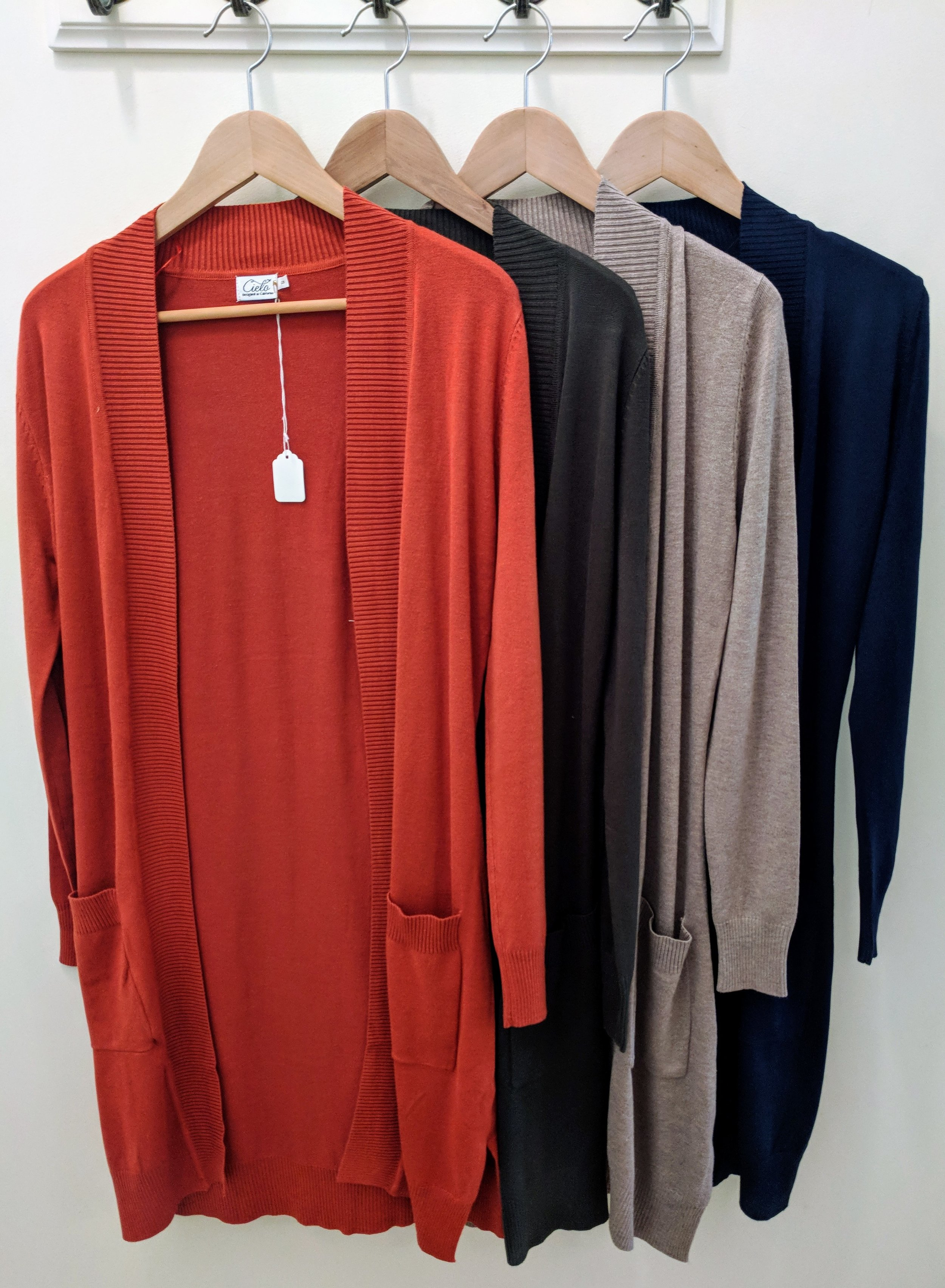 Rust, Olive, Camel, and Navy long open front cardigan with front pocket.