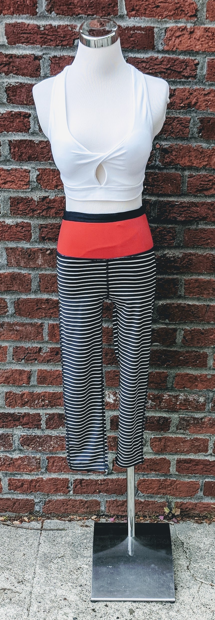 Navy and white stripe capri leggings with red-orange color block waist.