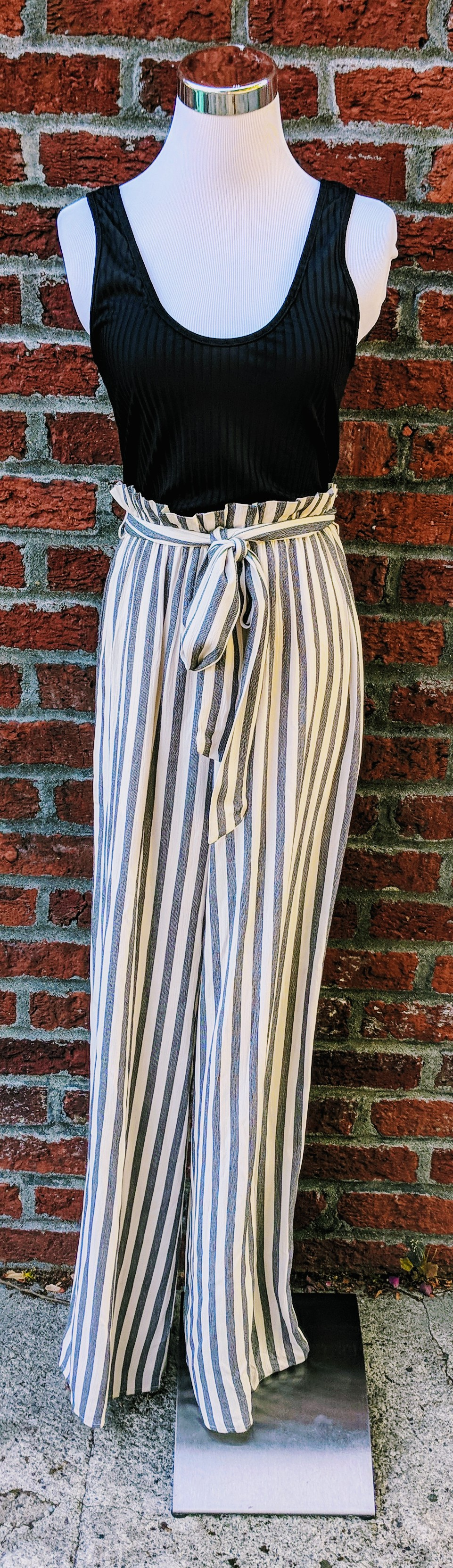 Black and white stripe jumpsuit with belted waist.