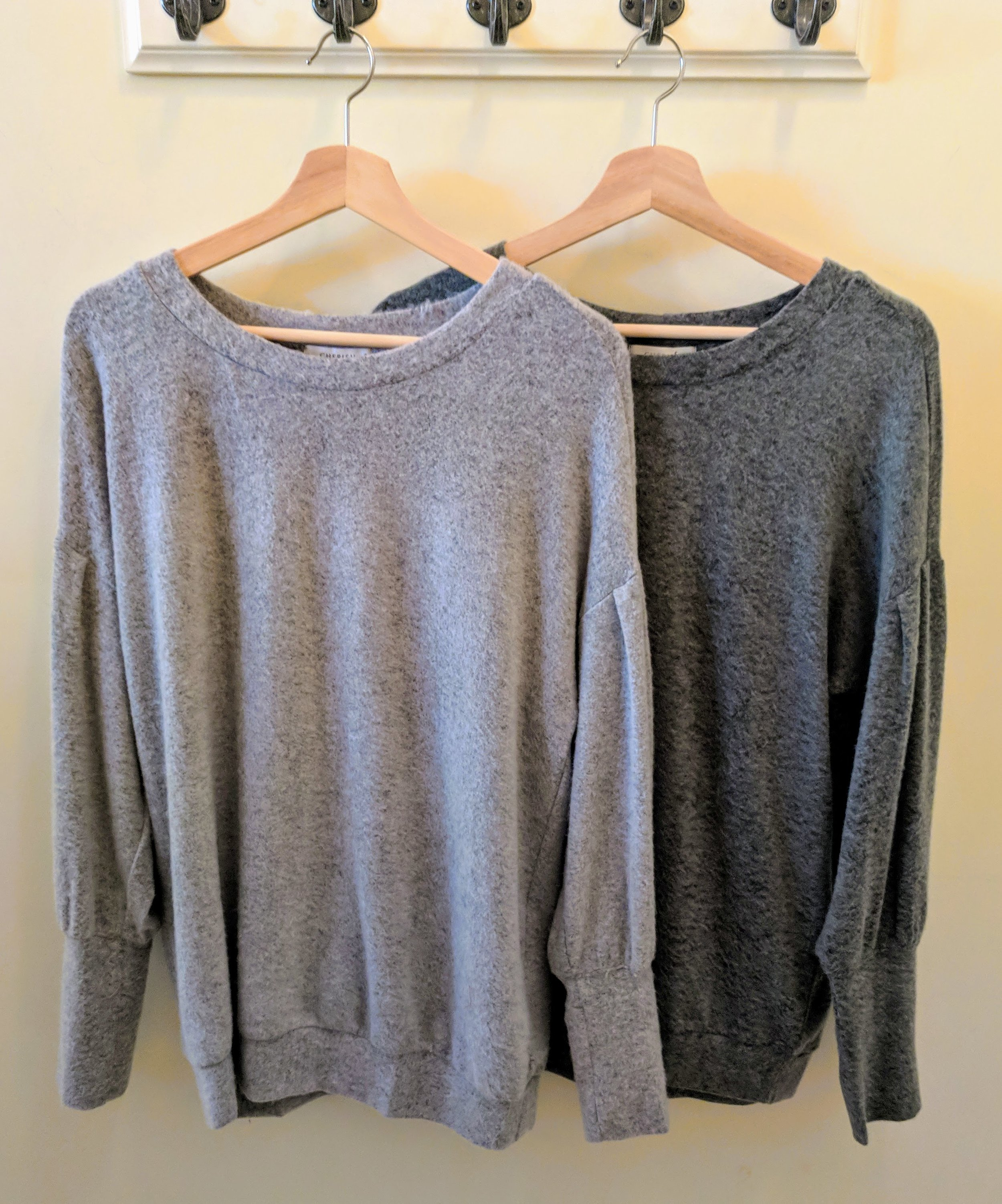 Heather Grey and Olive sweater with balloon sleeve and round neck.