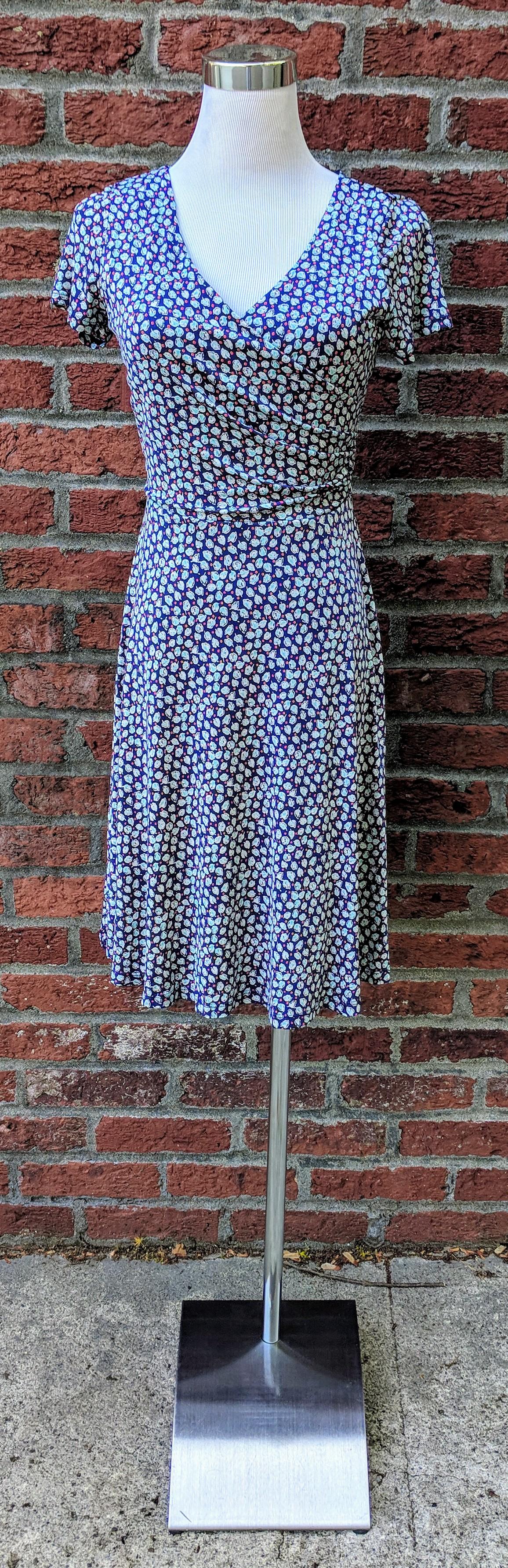 Navy mosaic wrap dress with empire waist.