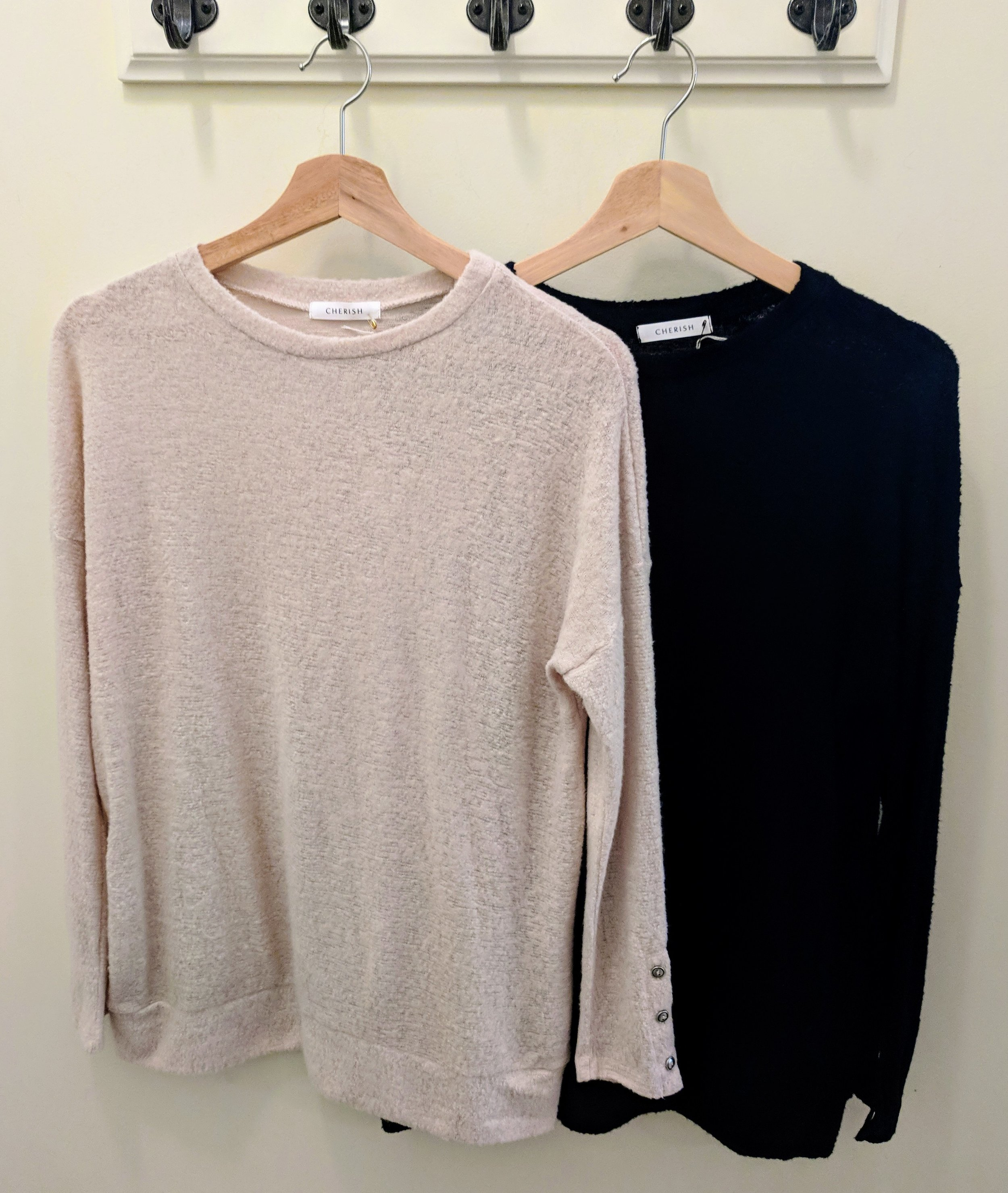 Cream and Black sweater with drop shoulder and button sleeves.