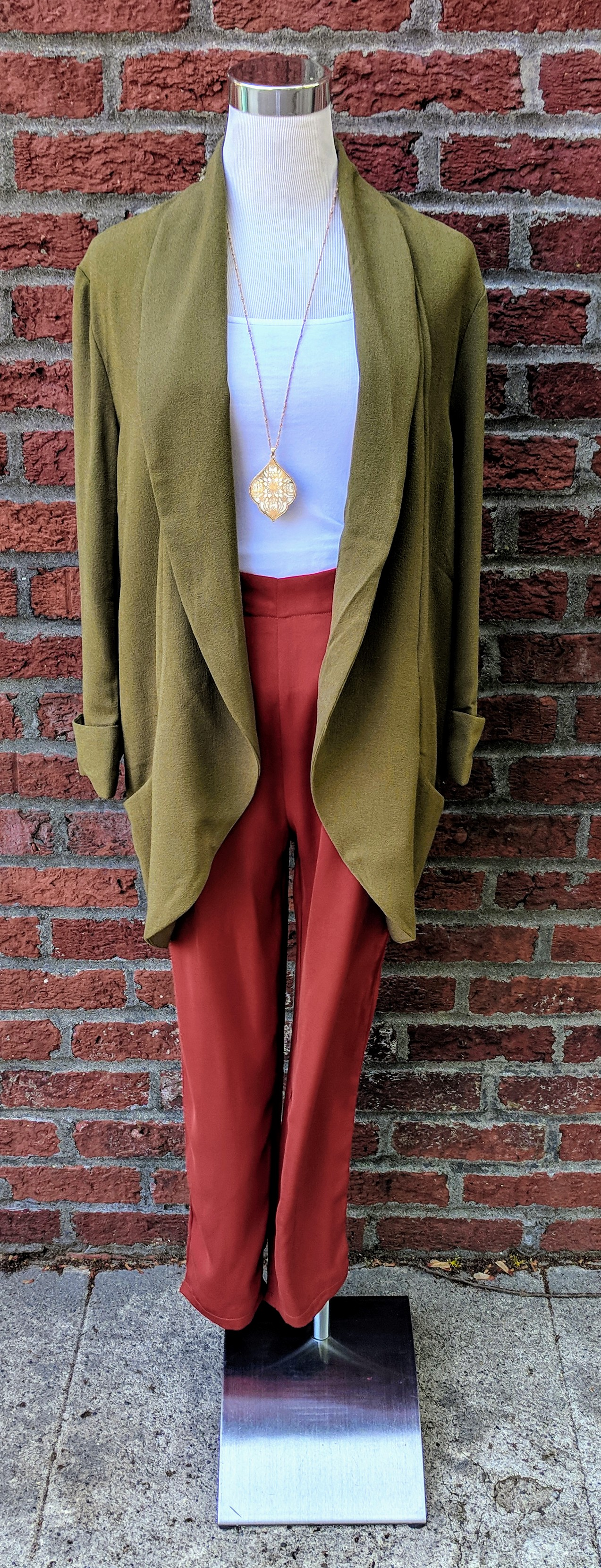 Olive modern blazer with open front lapel paired with Brick color pleated trousers.