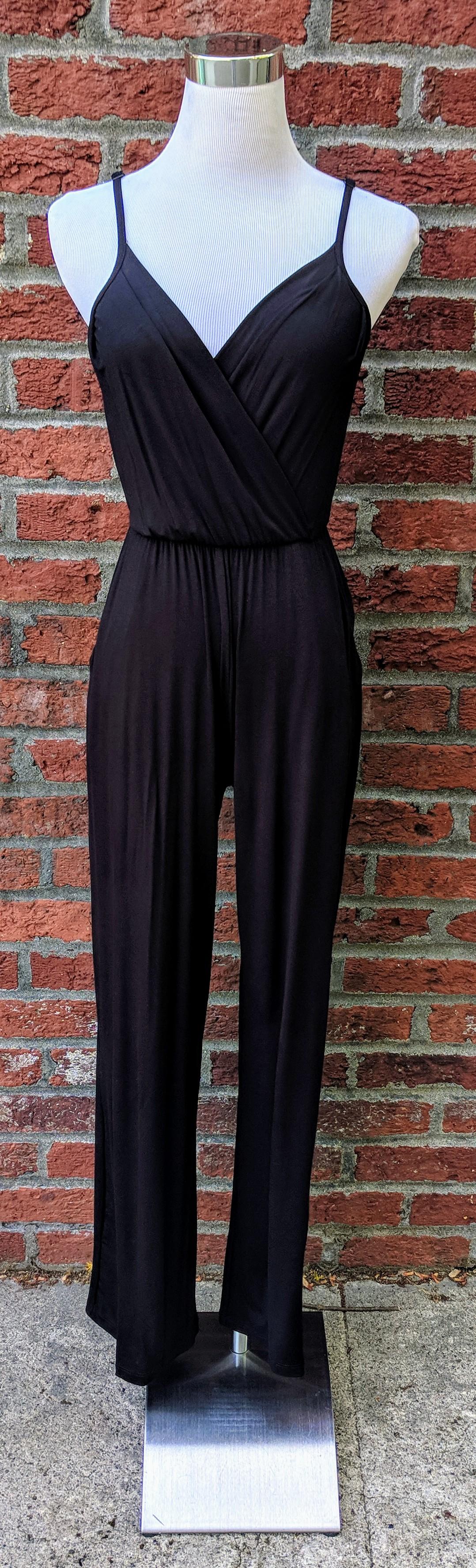 Black jumpsuit with overlapped v-neckline and pockets.